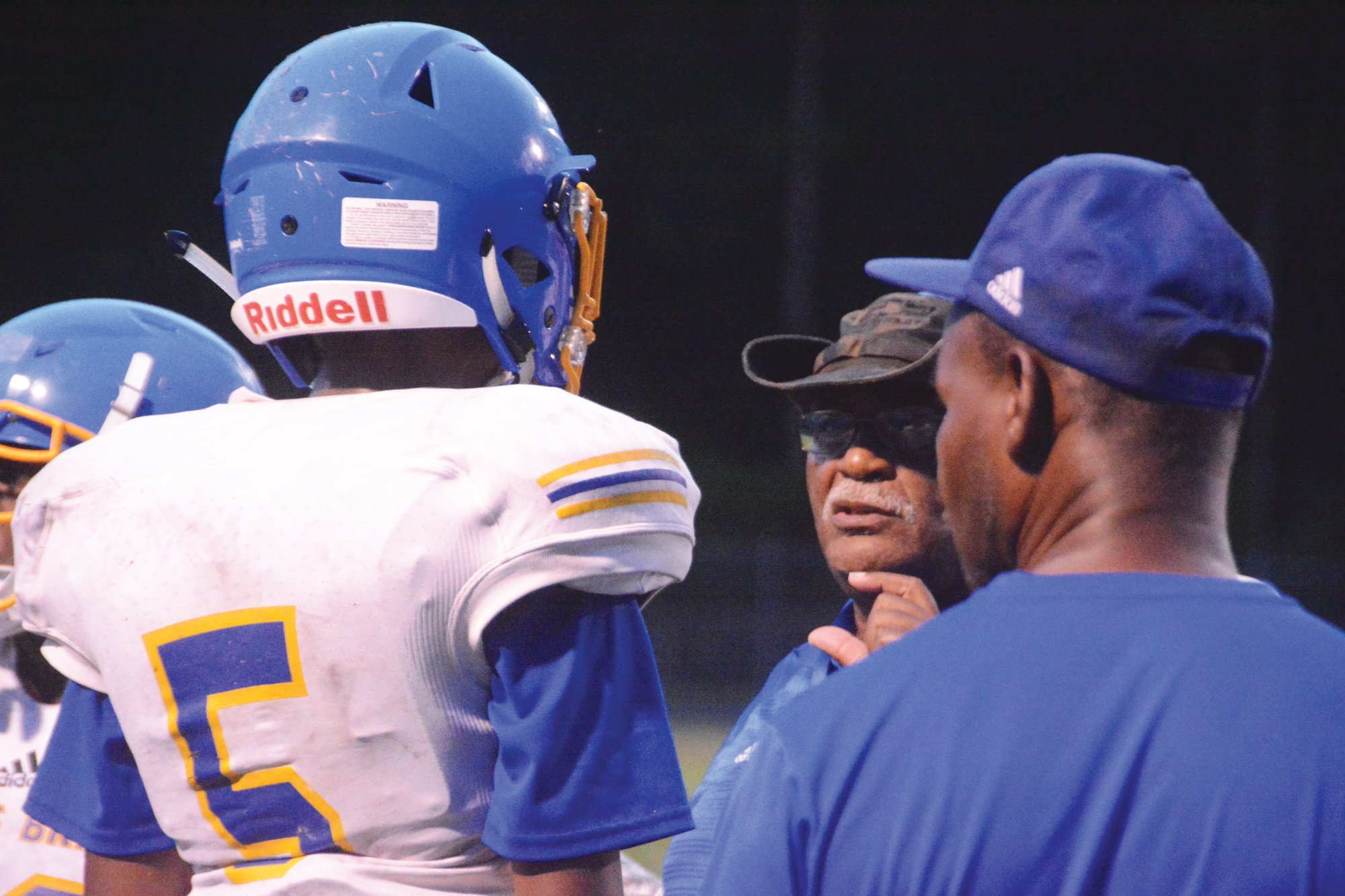 Scott's Branch head coach Leonard Johnson, center, will lead the Eagles against winless Hemingway in the first round of the SCHSL A playoffs on Friday.