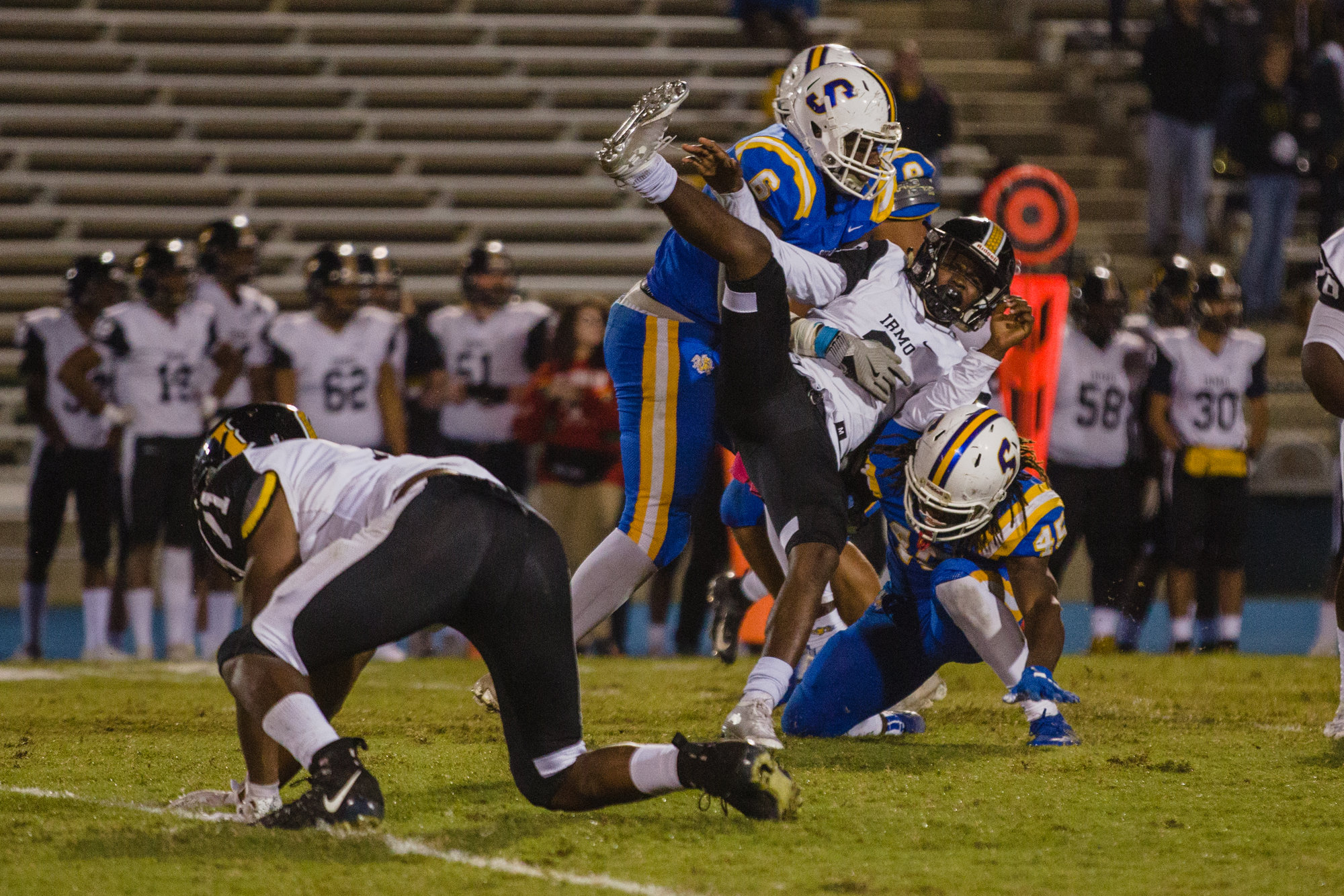 Sumter defensive end Justus Boone (6) and linebacker Kirkland Boone (45) hit an Irmo player on Friday night.