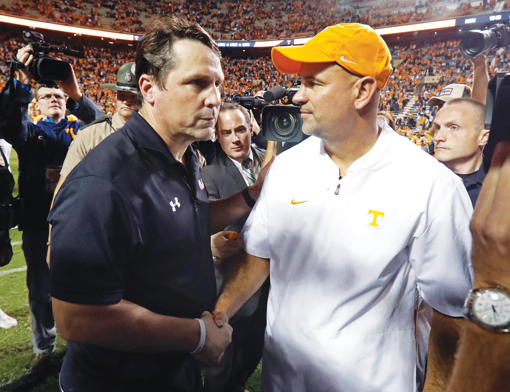 THE ASSOCIATED PRESSTennessee head  coach Jeremy Pruitt  shakes hands with  South Carolina head  coach Will Muschamp  after the Volunteers' 41-21 victory in Knoxville, Tennessee, last month. Both teams are trying to become bowl-eligible.