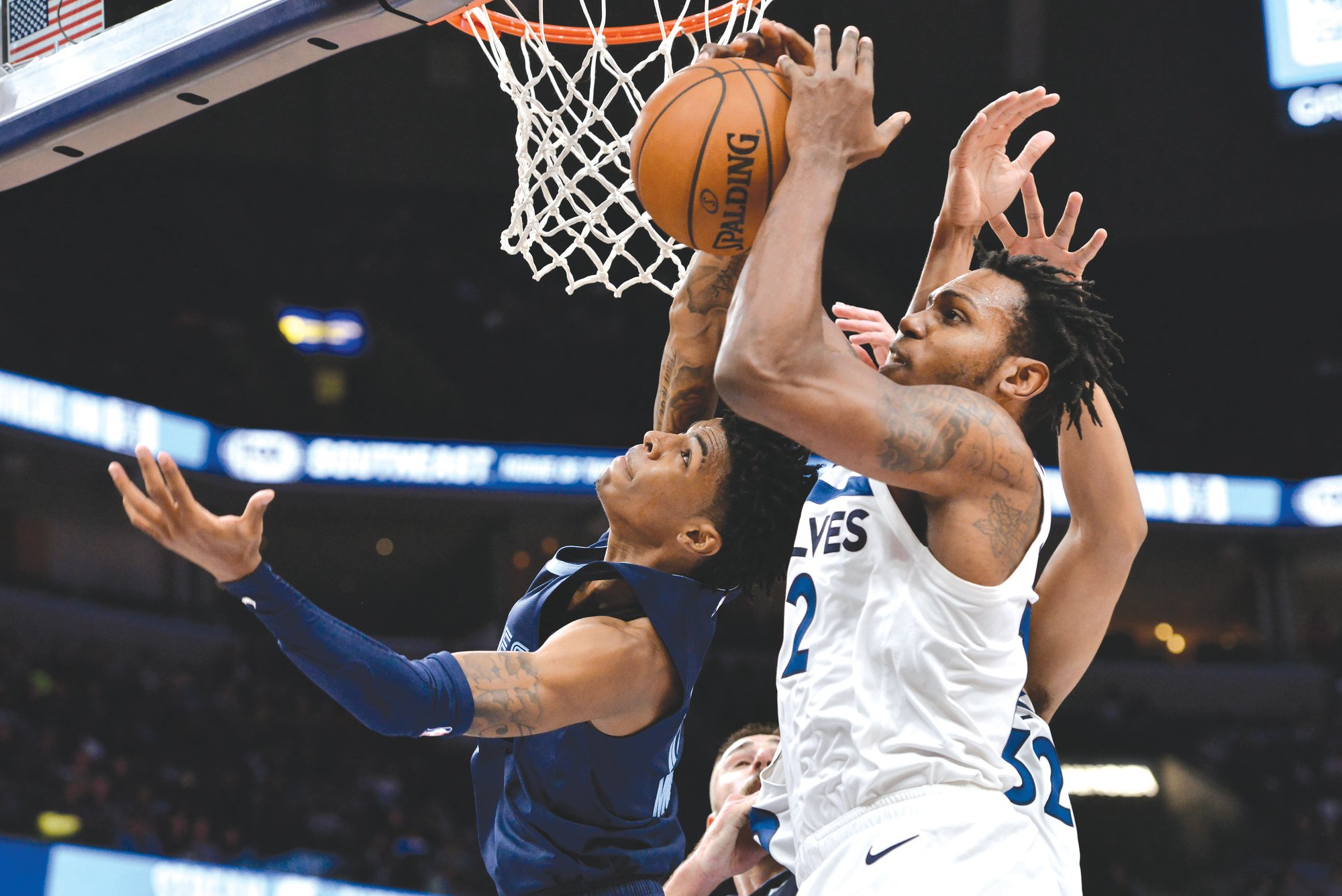 Memphis guard Ja Morant, left, Is fouled by Minnesota forward  Treveon Graham during the Grizzlies' 137-121 victory on Wednesday in Memphis, Tennessee. Morant scored 26 points.