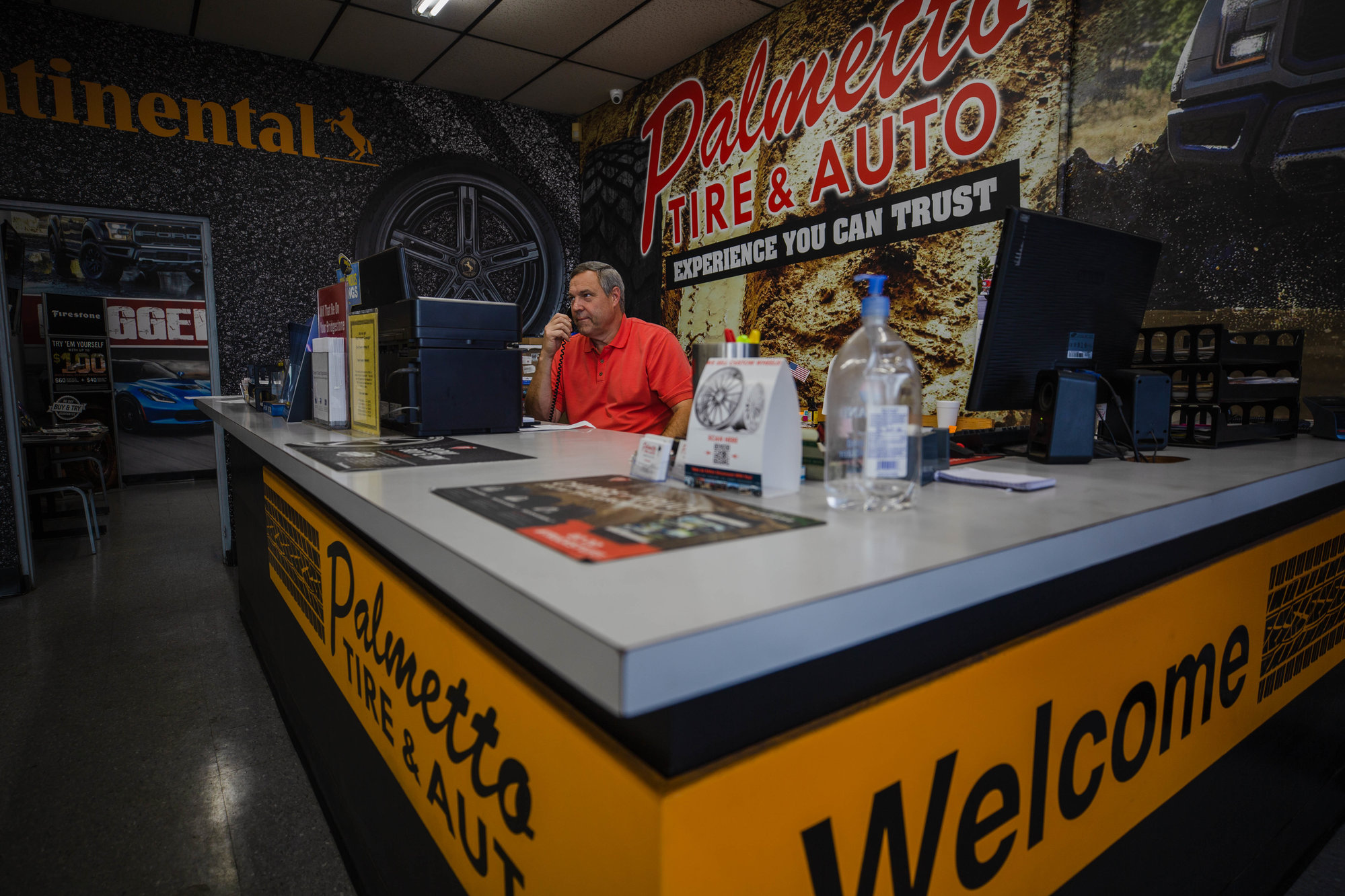 Palmetto Tire and Auto owner Philip Marlowe sits behind the desk in the store's main office area on Thursday. The tire and auto repair shop has received an outpouring of community support since an Oct. 21 shooting incident, he said.