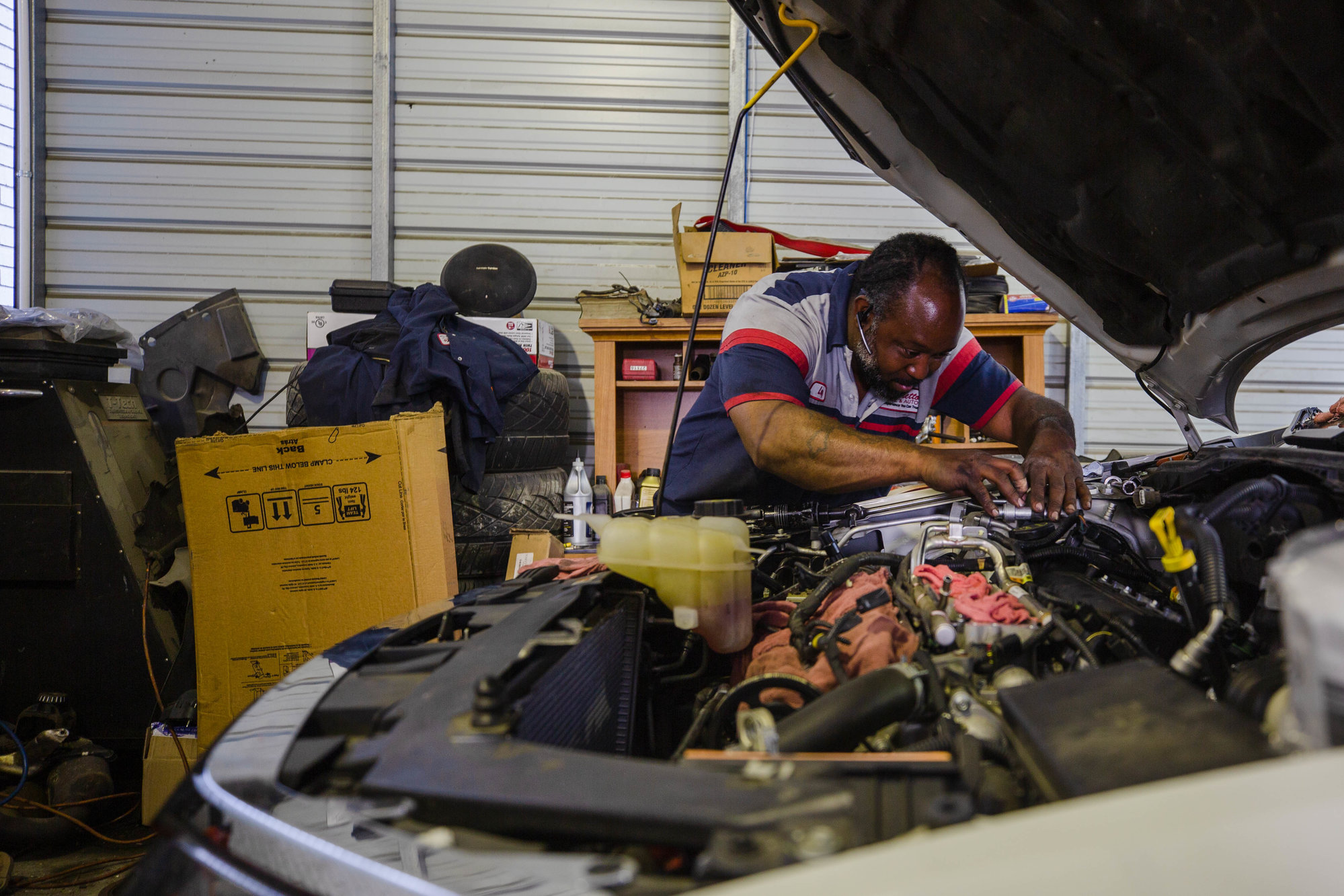 A Palmetto Tire and Auto mechanic works on a vehicle Thursday. The tire and auto repair shop has received an outpouring of community support since a shooting incident on Oct. 21, according to owner Philip Marlowe.