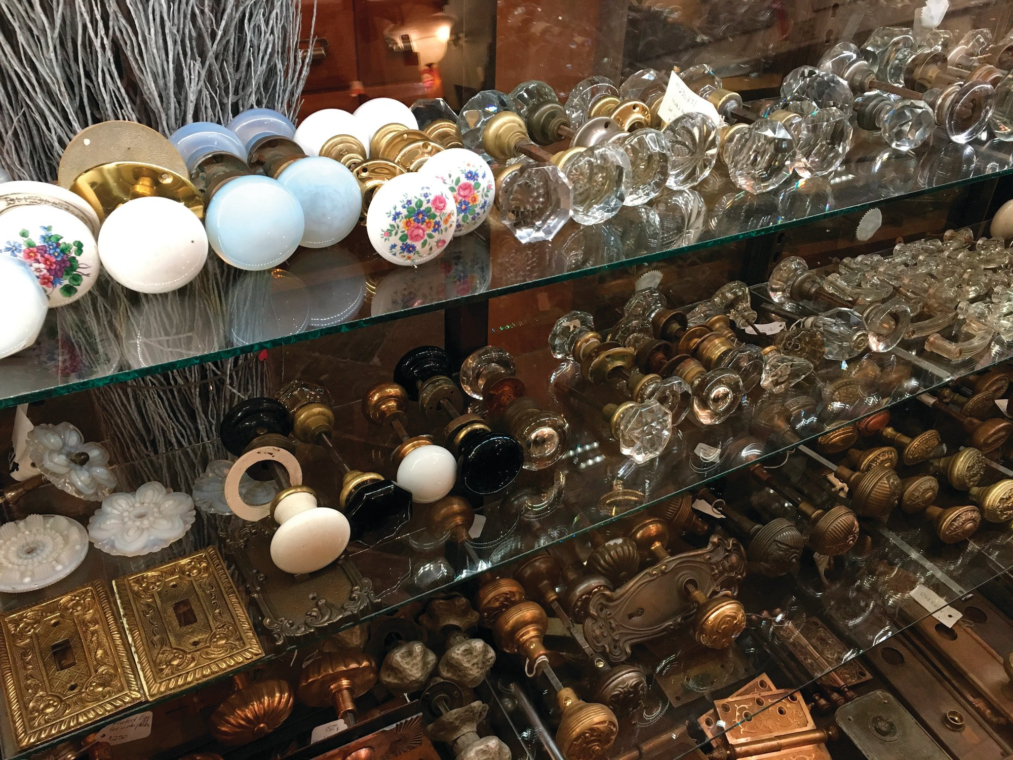 PHOTOS BY KATHERINE ROTH VIA AP Seen is a selection of vintage doorknobs and other items available for sale at Olde Good Things salvage store in New York.