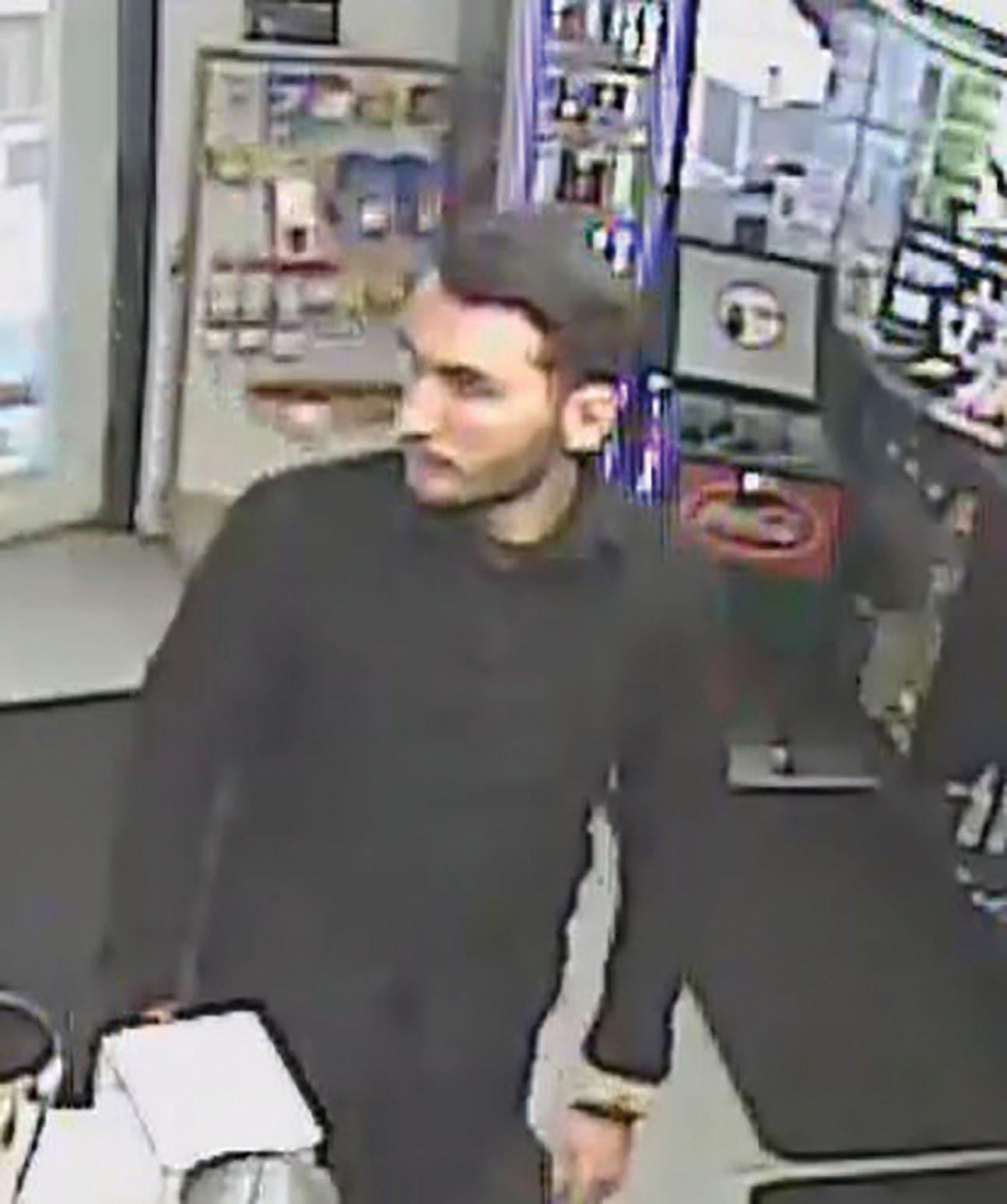Photo provided by Franklin County Sheriff's Office  Seen in this photo taken from a gas station video is 22-year-old Michael A. Brown, who is wanted on a second-degree murder charge.