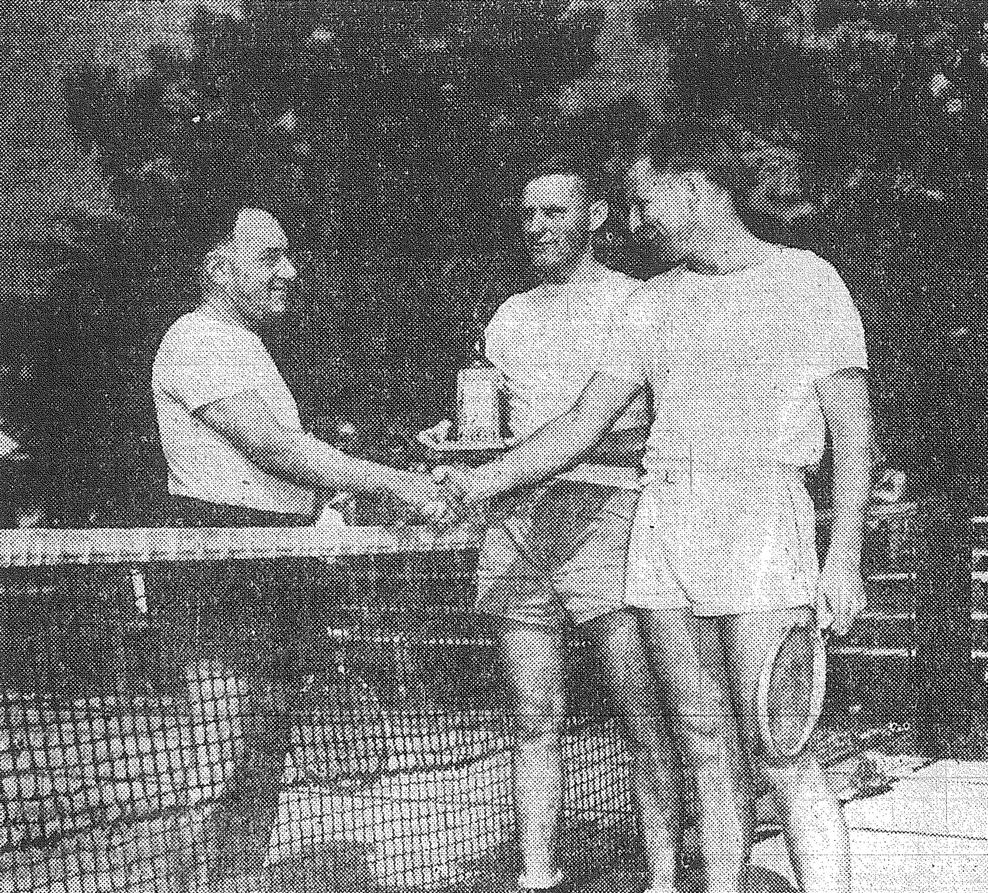 SUMTER ITEM FILE PHOTO  1945 - Capt. Louis Levy, left, meets Lt. Don Heselwood after finals play in the Shaw Field officers' tennis tournament June 9. Lt. Kenneth Mattson is seen standing by to present the award, donated by the Officers' Club.