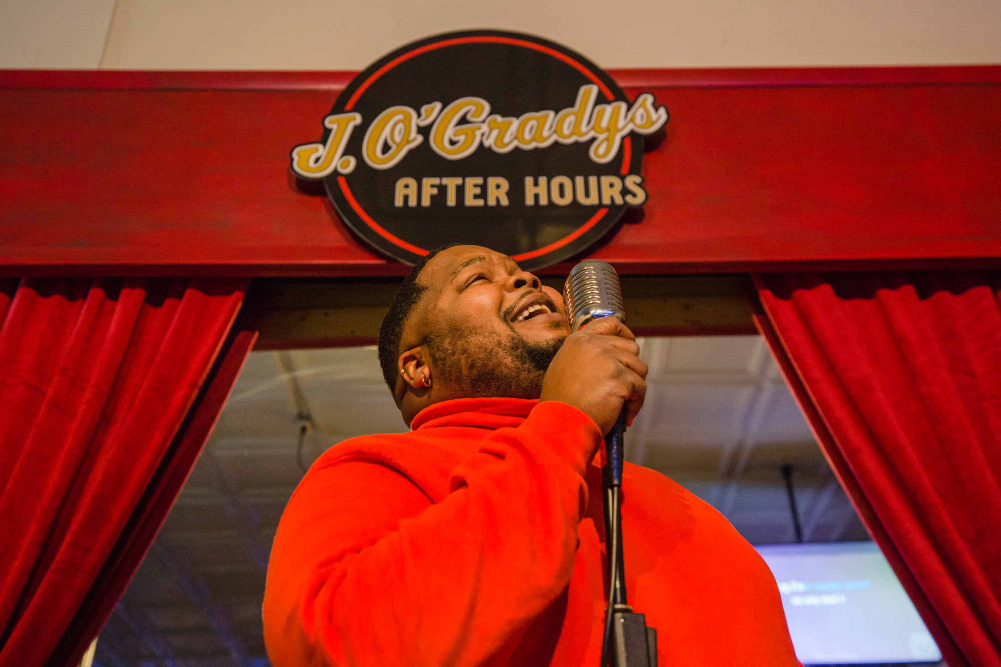 Christopher Conyers sings to the crowd at J. O'Grady's After Hours on Thursday night.