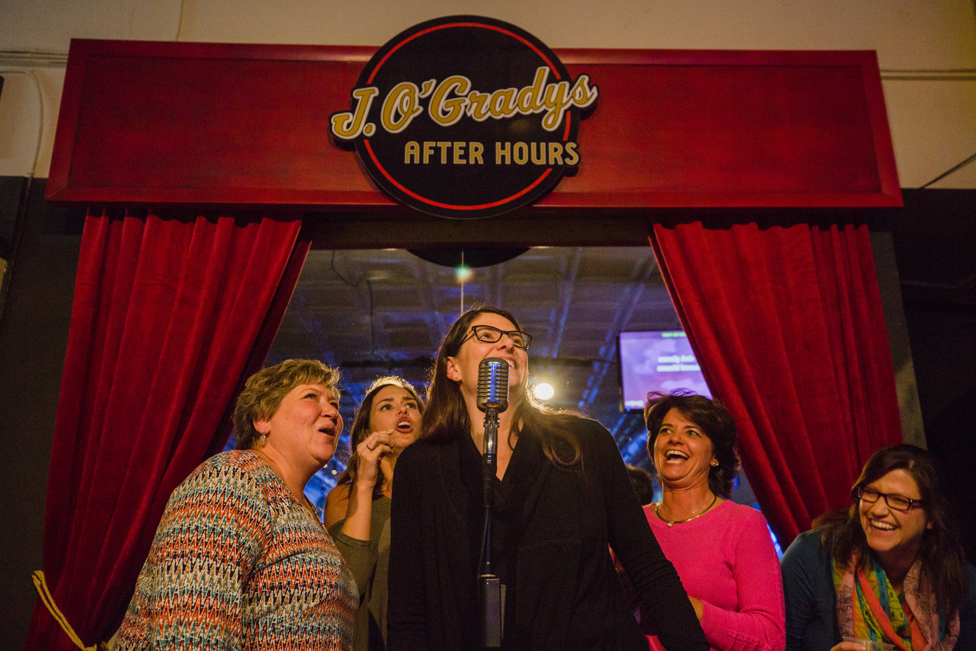 Kelly Bergeron, Virginia Schaefer, Melony Burgess, Lee Knopf and Denna Rentz sing together on Thursday.