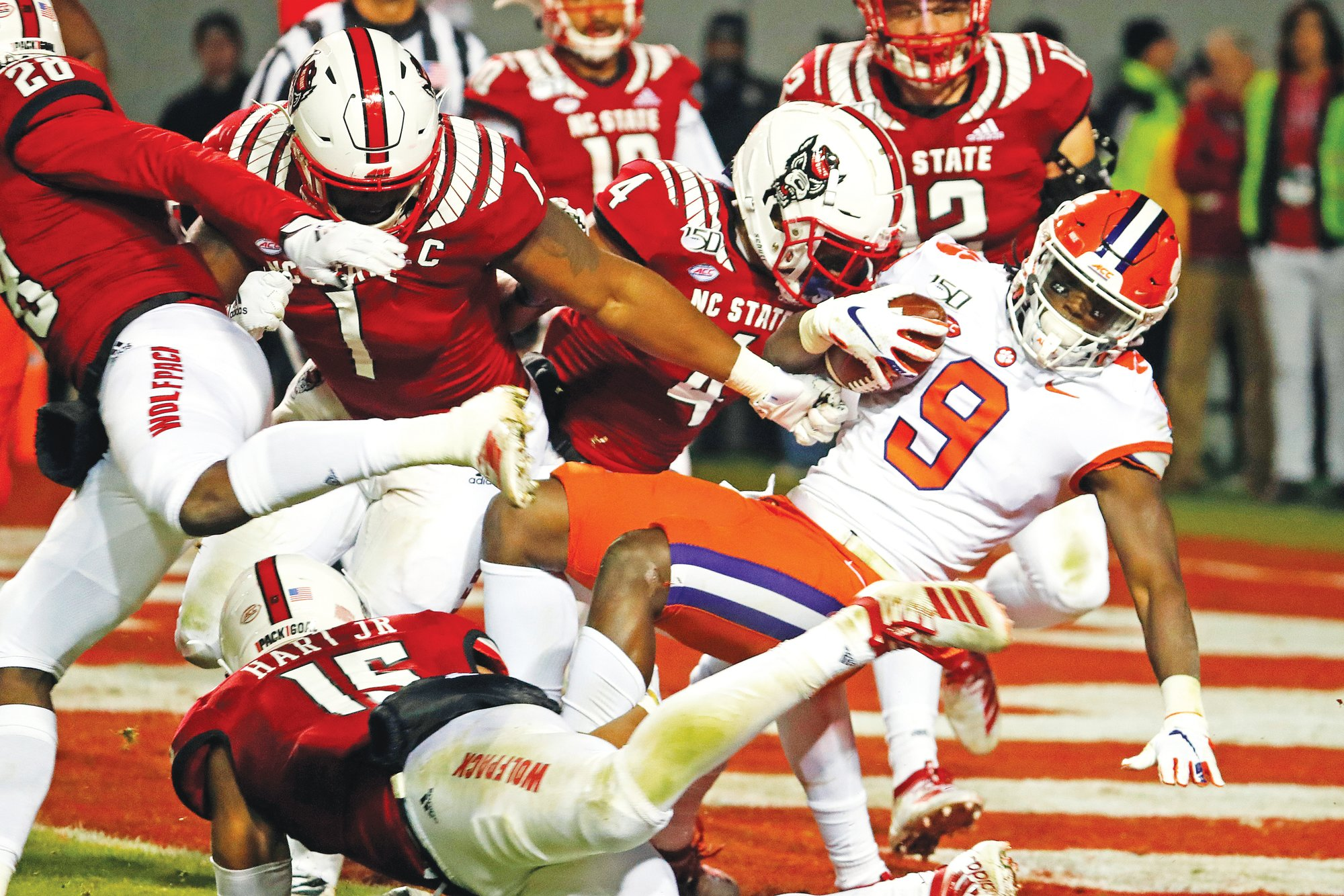 Clemson running back Travis Etienne (9) breaks through against North Carolina State defenders to score during the Tigers' 55-10 win in Raleigh, North Carolina last week. Clemson plays host to Wake Forest on Saturday.