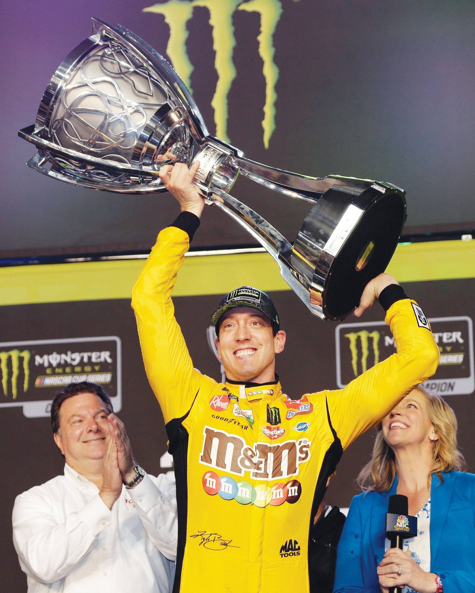 Kyle Busch holds up his trophy in Victory Lane after winning a NASCAR Cup Series auto racing season championship on Sunday, Nov. 17, 2019, at Homestead-Miami Speedway in Homestead, Fla.