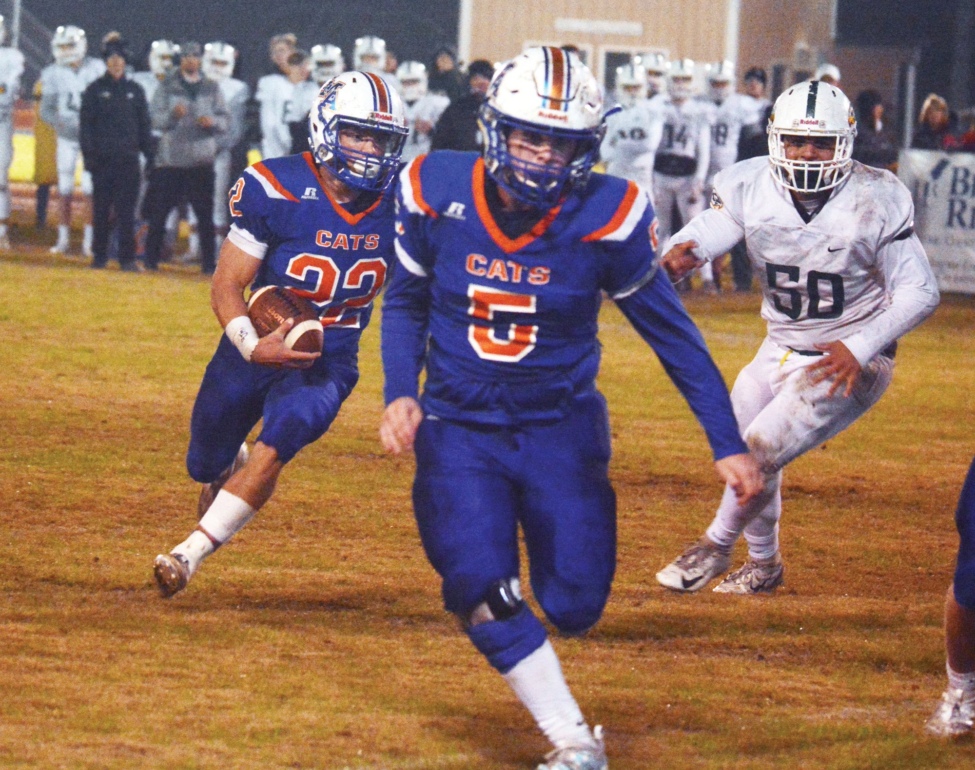 Laurence Manning running back Wyatt Rowland (22) carries the ball behind a lead block from Nolan Osteen (5) during their 48-42 win over Ben Lippen on Friday. . LMA will take on Hammond on Saturday in Columbia beginning at 3:30 p.m. for the state title.