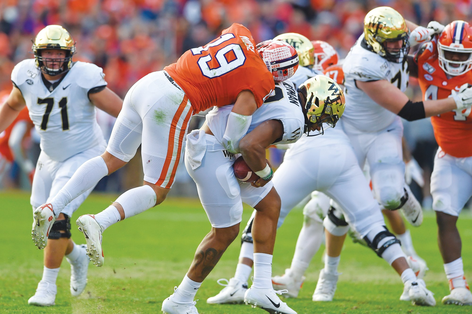 Clemson safety Tanner Muse (19) sacks Wake Forest quarterback Jamie Newman during the Tigers' 52-3 win on Saturday in Clemson.