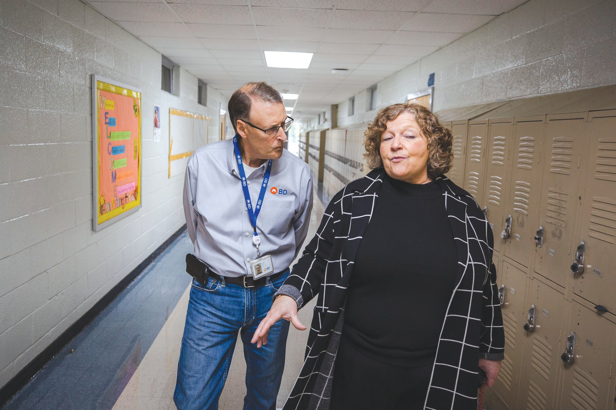 Ebenezer Middle School Principal Marlene DeWit walks the hallways of the school with Autry.