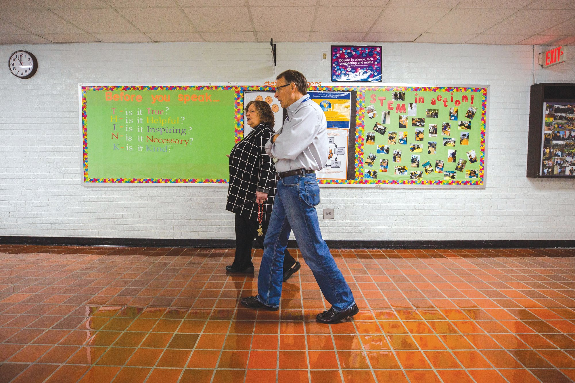 Ebenezer Middle School Principal Marlene DeWit walks the hallways of the school with Mark Autry, BD business unit manager, as a part of the Sumter School District's Principal for a Day program.