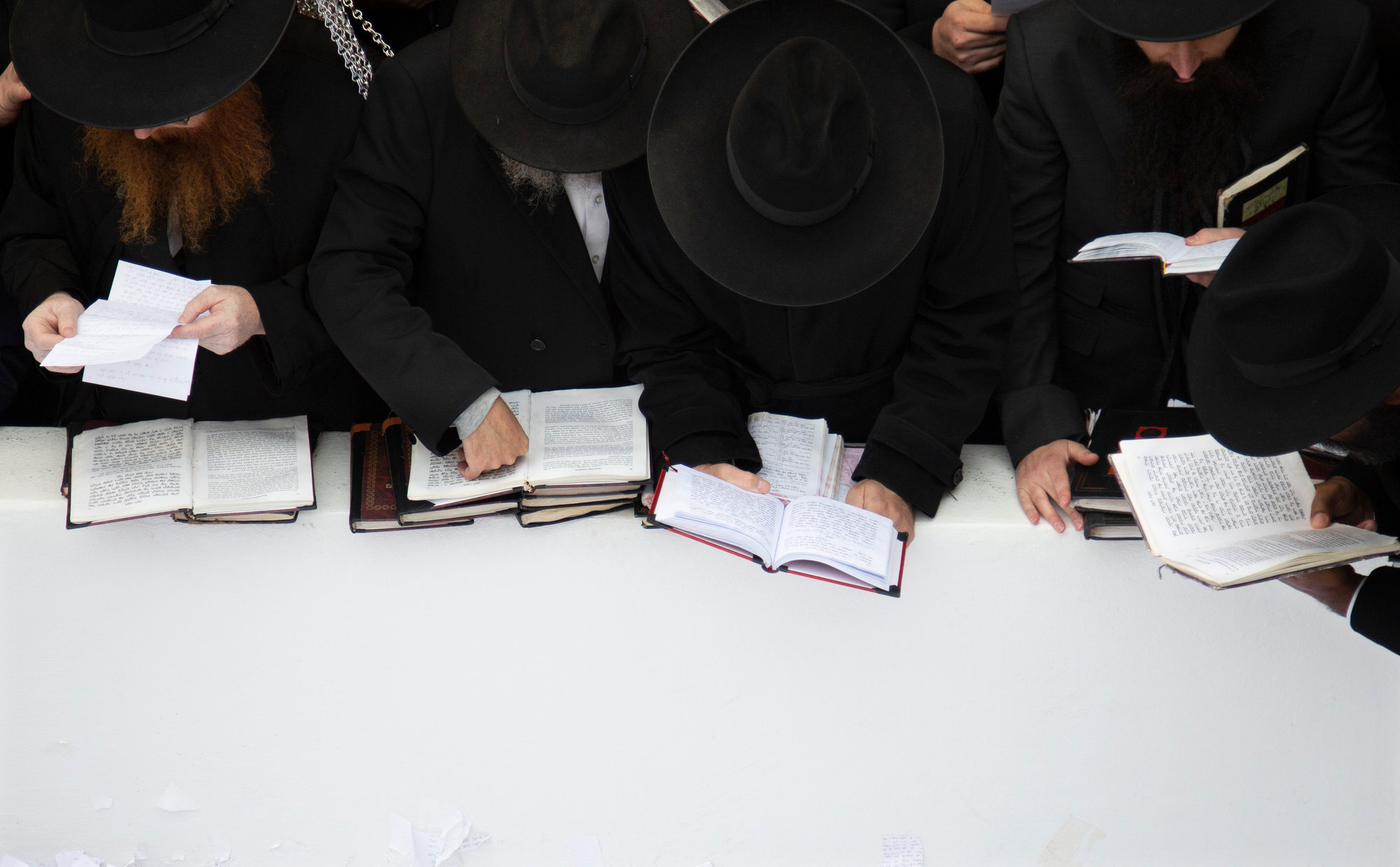 The Associated Press Hasidic leaders read personal notes and prayers at the resting place of the late Rabbi Menachem Mendel Schneerson, known as the Lubavitcher Rebbe, while attending the annual International Conference of Chabad-Lubavitch Emissaries at Montefiore Cemetery in New York on Nov. 22.