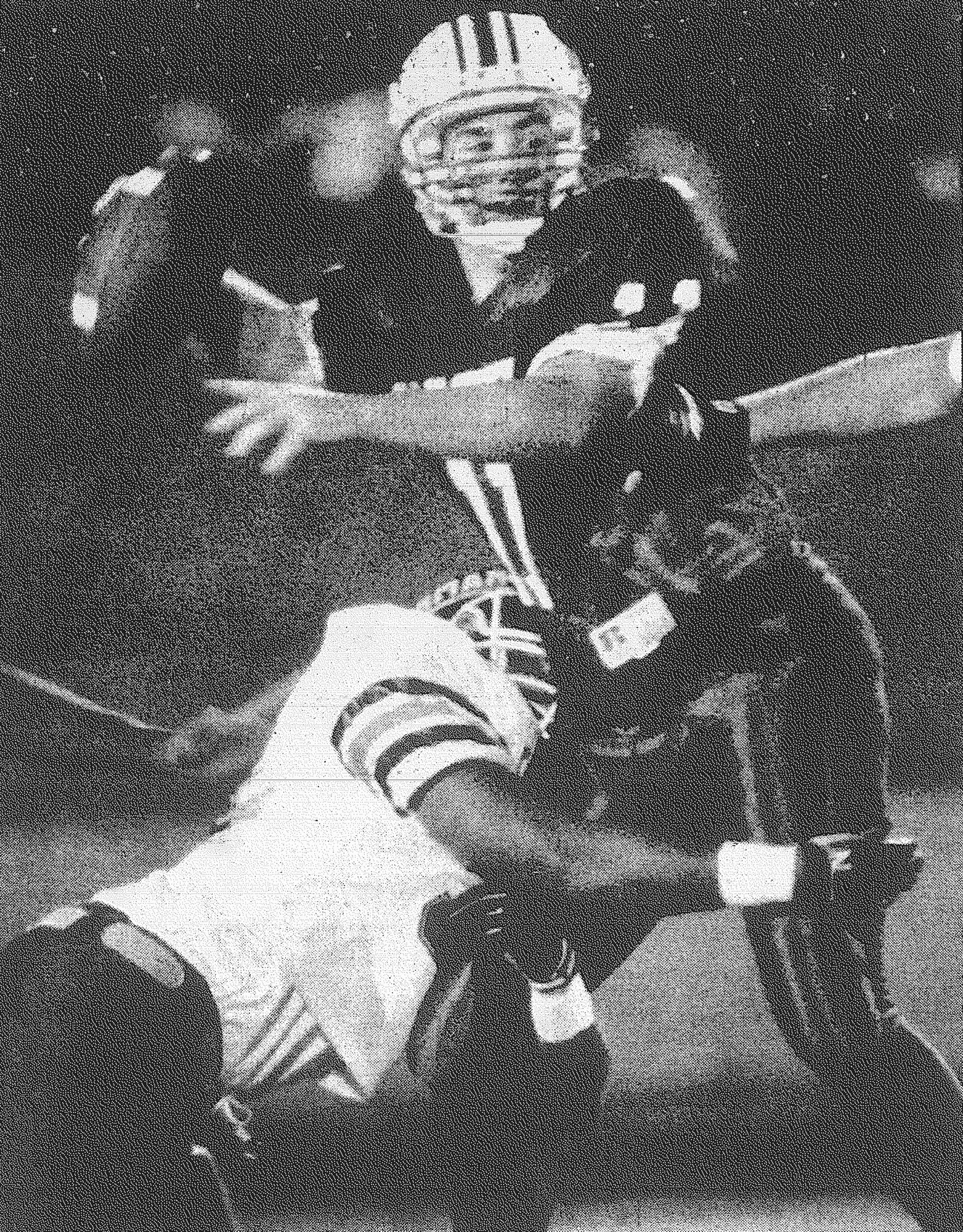 1994 - Sumter quarterback John Blanding looks downfield for a receiver as a Dorman defender wraps him up during the 4A Division I semifinal game Nov. 26.