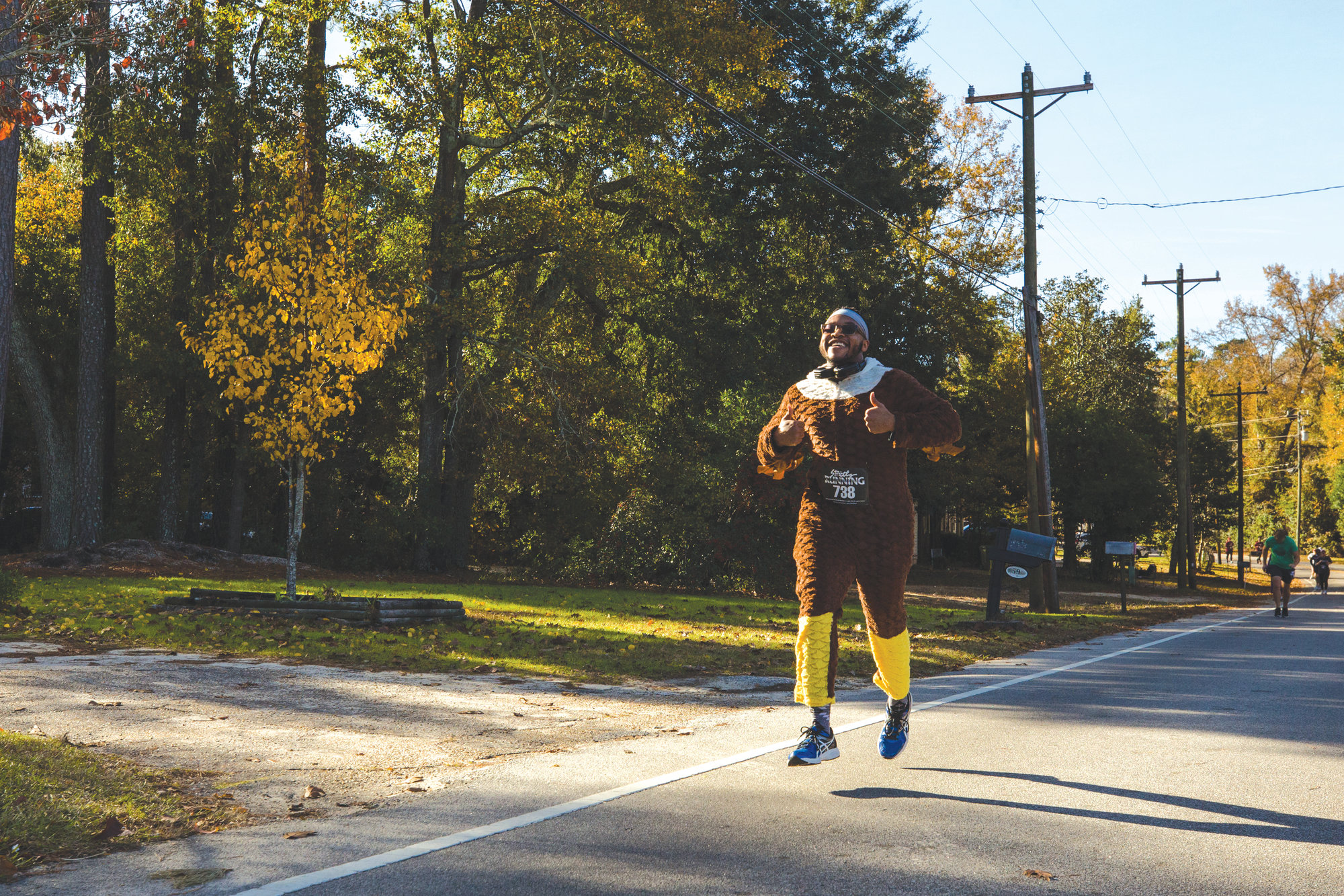 Teresa Jones approaches the finish line of the Thanksgiving Day Turkey Trot.