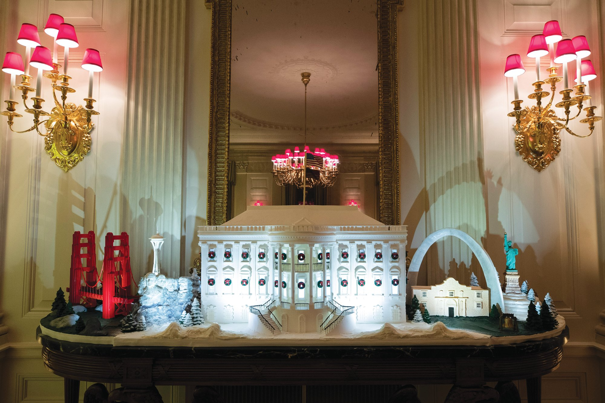 The White House made of gingerbread in the State Dining Room features landmarks from across the country.