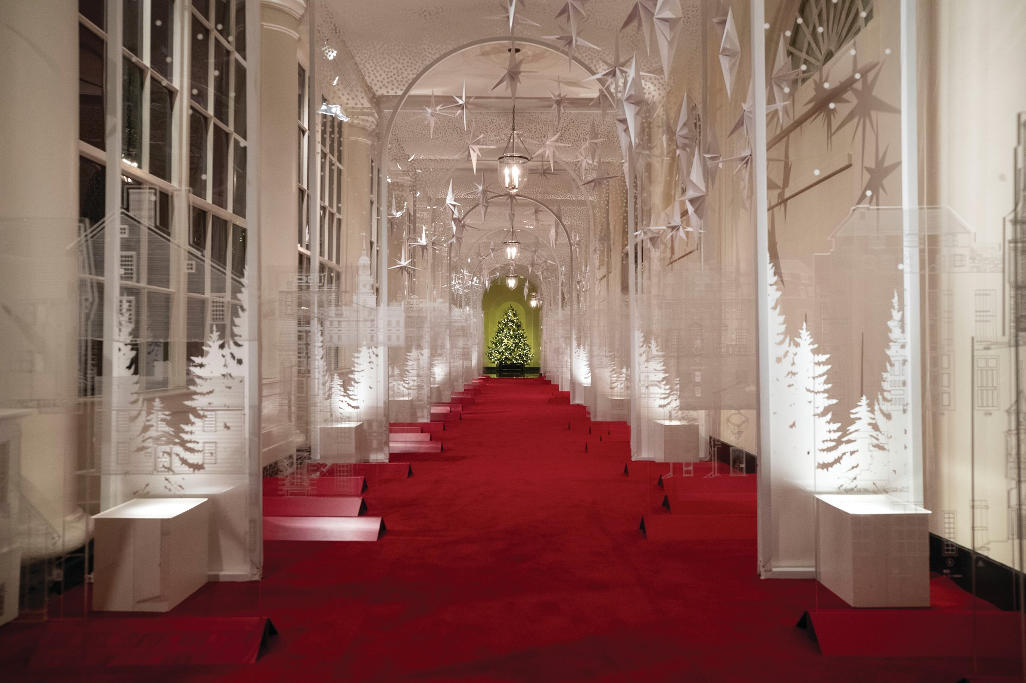 PHOTOS BY THE ASSOCIATED PRESS  The East Colonnade of the White House decorated for Christmas is lined with double rows of see-through panels etched with more than 60 examples of American design, innovation and architecture.