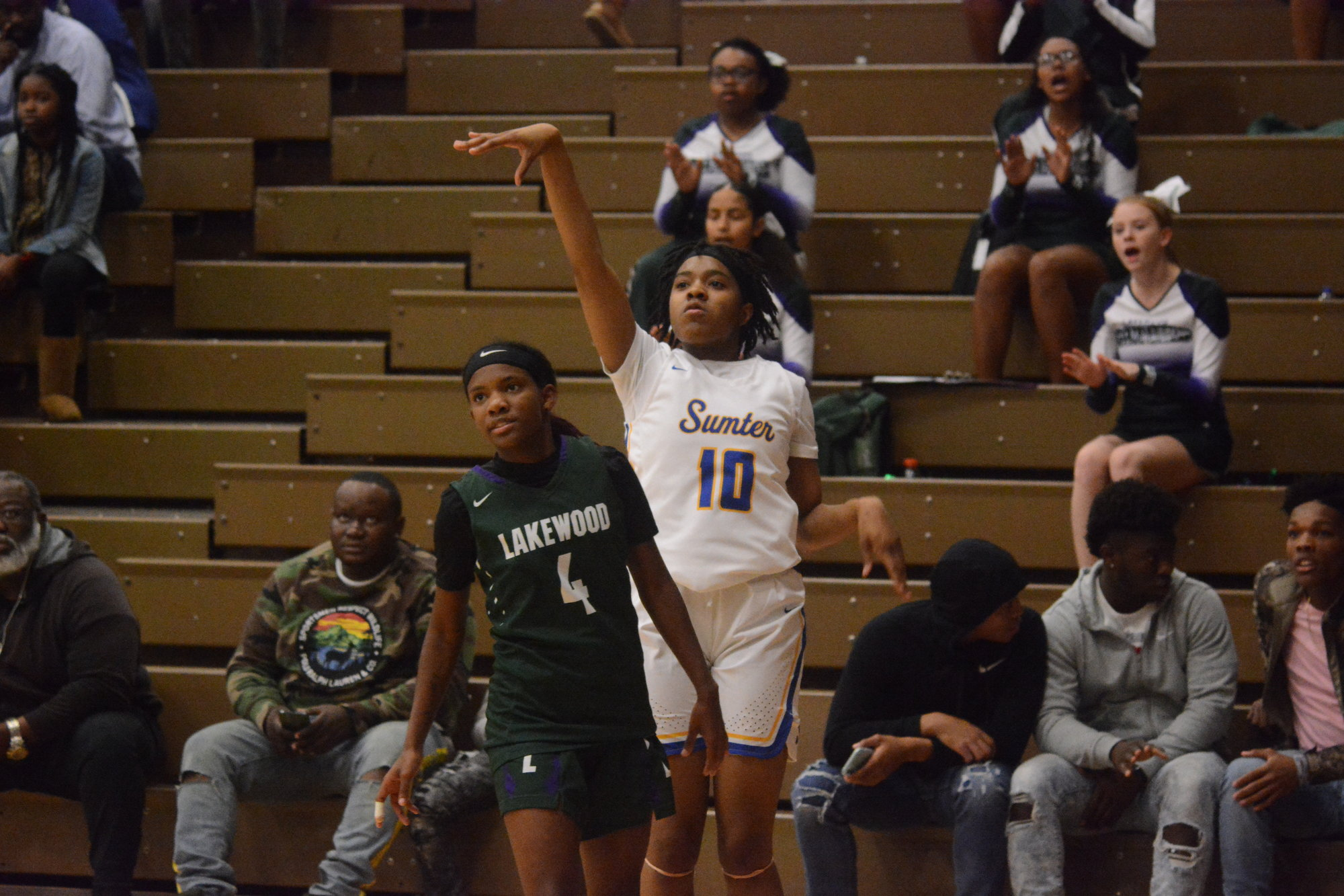 Tamerah Brown (10) watches a three point attempt against Lakewood on Saturday. Brown led all scorers with 18 points in the Lady Gamecocks' 76-27 win.
