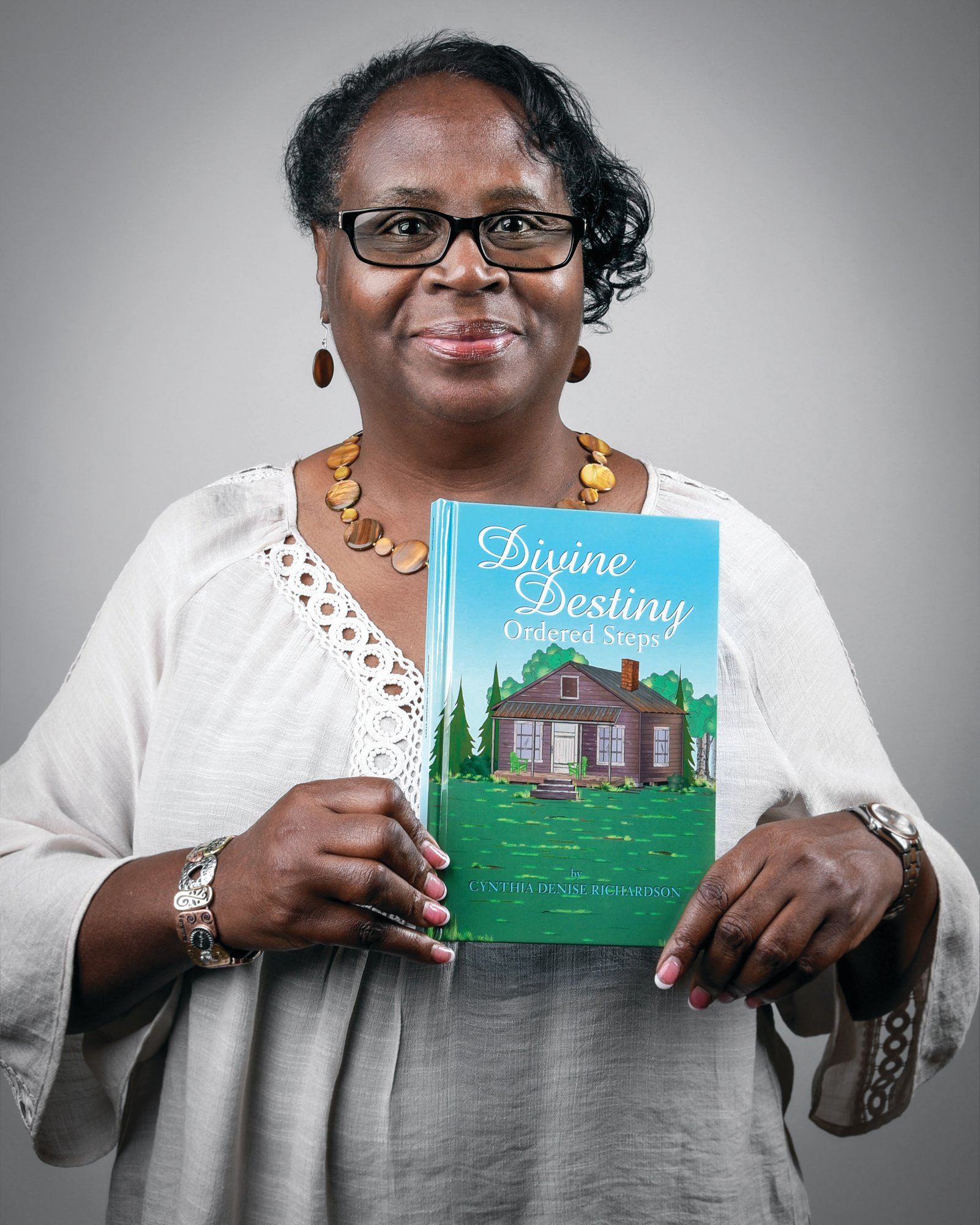 "PHOTO PROVIDED  Sumterite Cynthia Richardson holds the book she authored, ""Divine Destiny: Ordered Steps."""