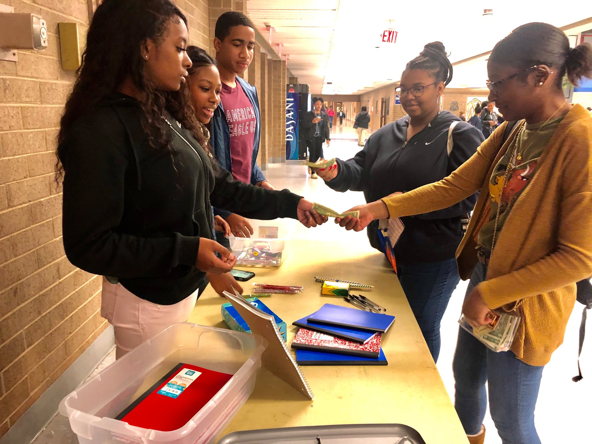 PHOTO PROVIDEDSumter High AVID students sell school supplies and other items to other students through the AVID school store recently.