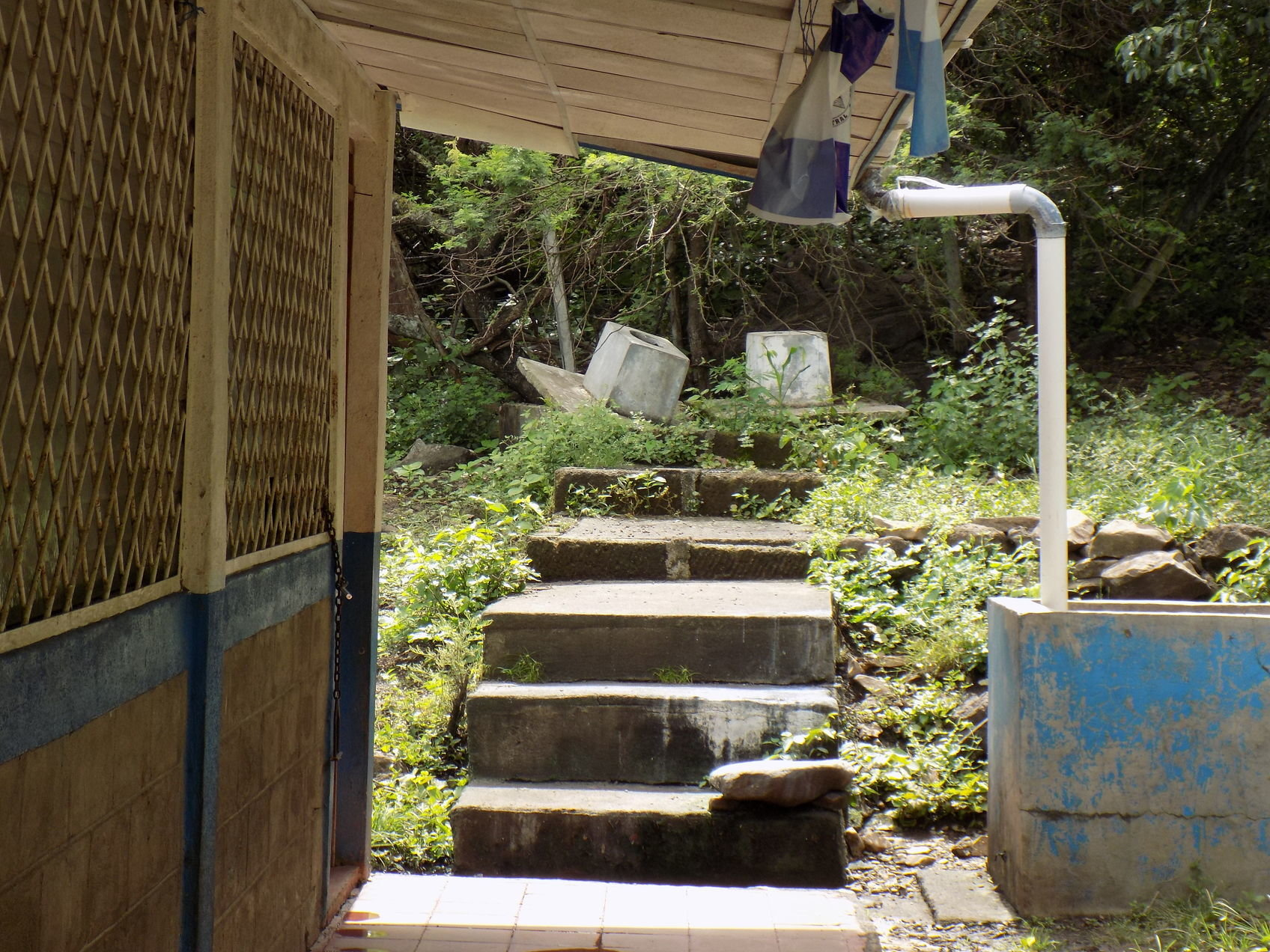 PHOTO PROVIDED  Dilapidated latrines sit a short distance away outside El Madrono school in Nicaragua. Sumter High School students have contributed to a service-learning project that is providing new latrines at the school.