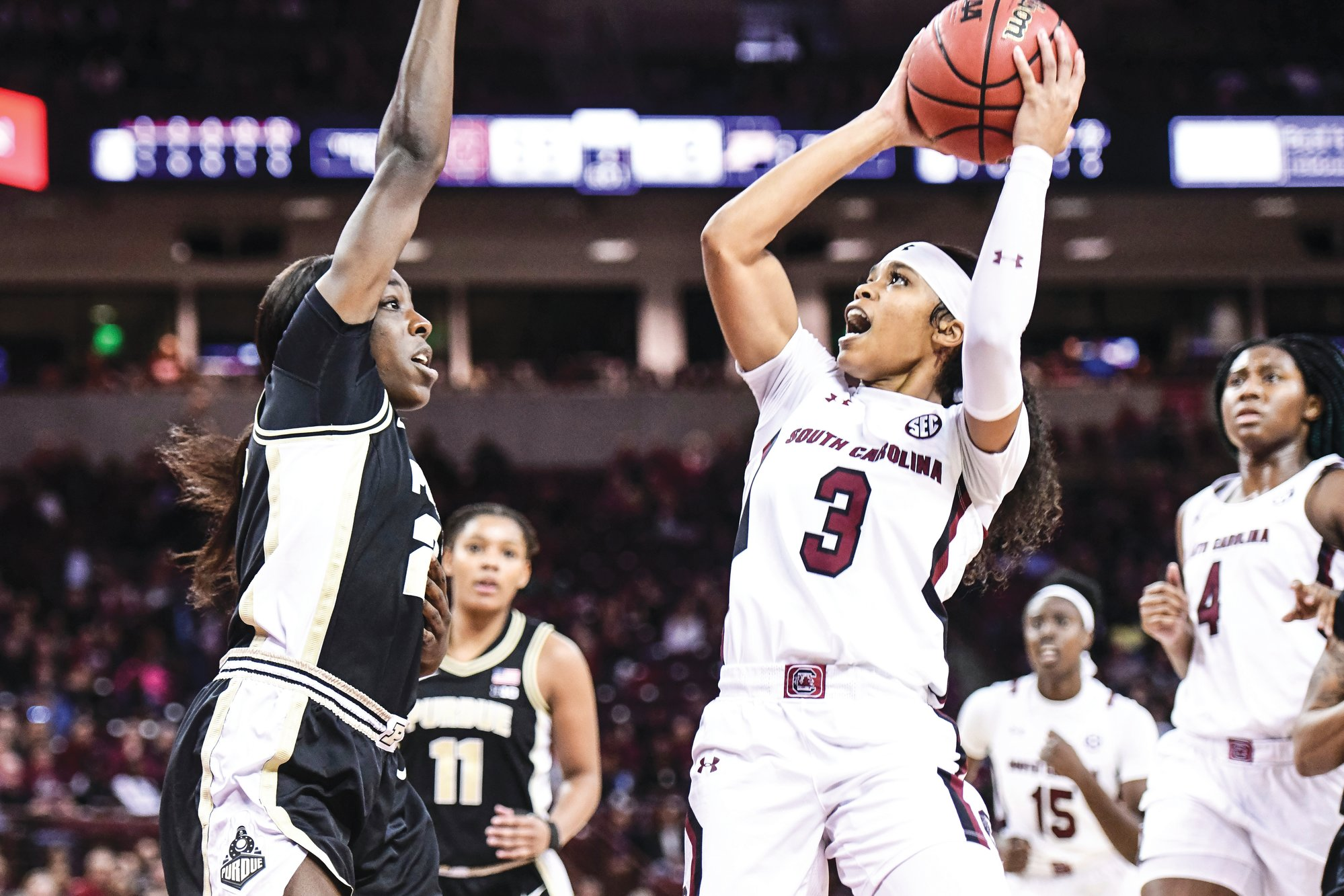 South Carolina guard Destanni Henderson (3) attempts a shot against Purdue guard Tamara Farquhar, left, during the Gamecocks' 85-49 win on Sunday in Columbia.