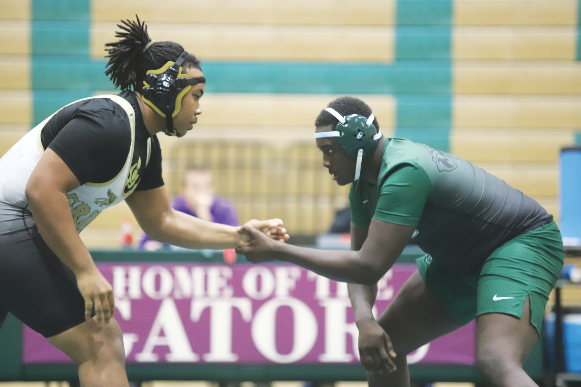 Lakewood's Stanley Boatright, right, has been one of the Gators' top wrestlers in the restart of the program after a 15-year hiatus. Boatright owns a 15-7 record in the 285-pound weight class.