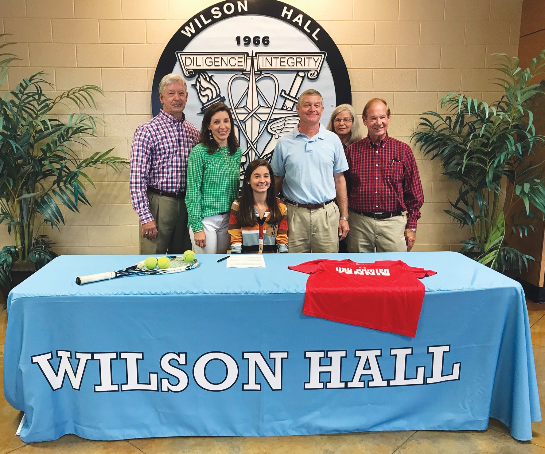 Wilson Hall's Emily Anne Beasley, seated, has signed to play tennis with the University of South Carolina Sumter. Pictured with Beasley, left to right, are grandfather David Branham, mother Mandy Beasley, father Chad Beasley, grandmother Rhonda Beasley and grandfather Arthur Beasley.