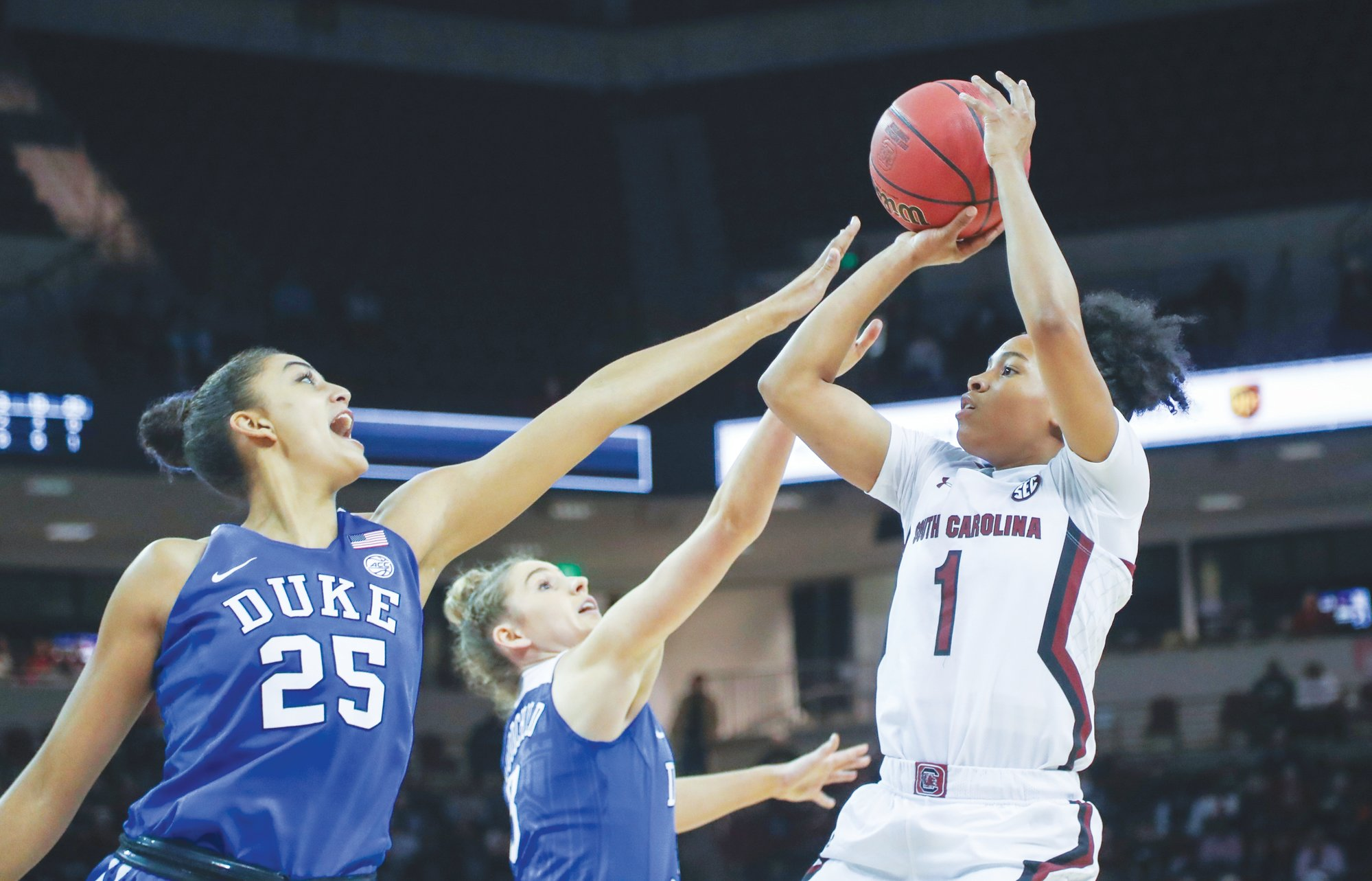 South Carolina's Zia Cooke (1) shoots as Duke's Jade Williams (25) and Miela Goodchild (3) defend during the Gamecocks' 89-46 win on Thursday in Columbia.