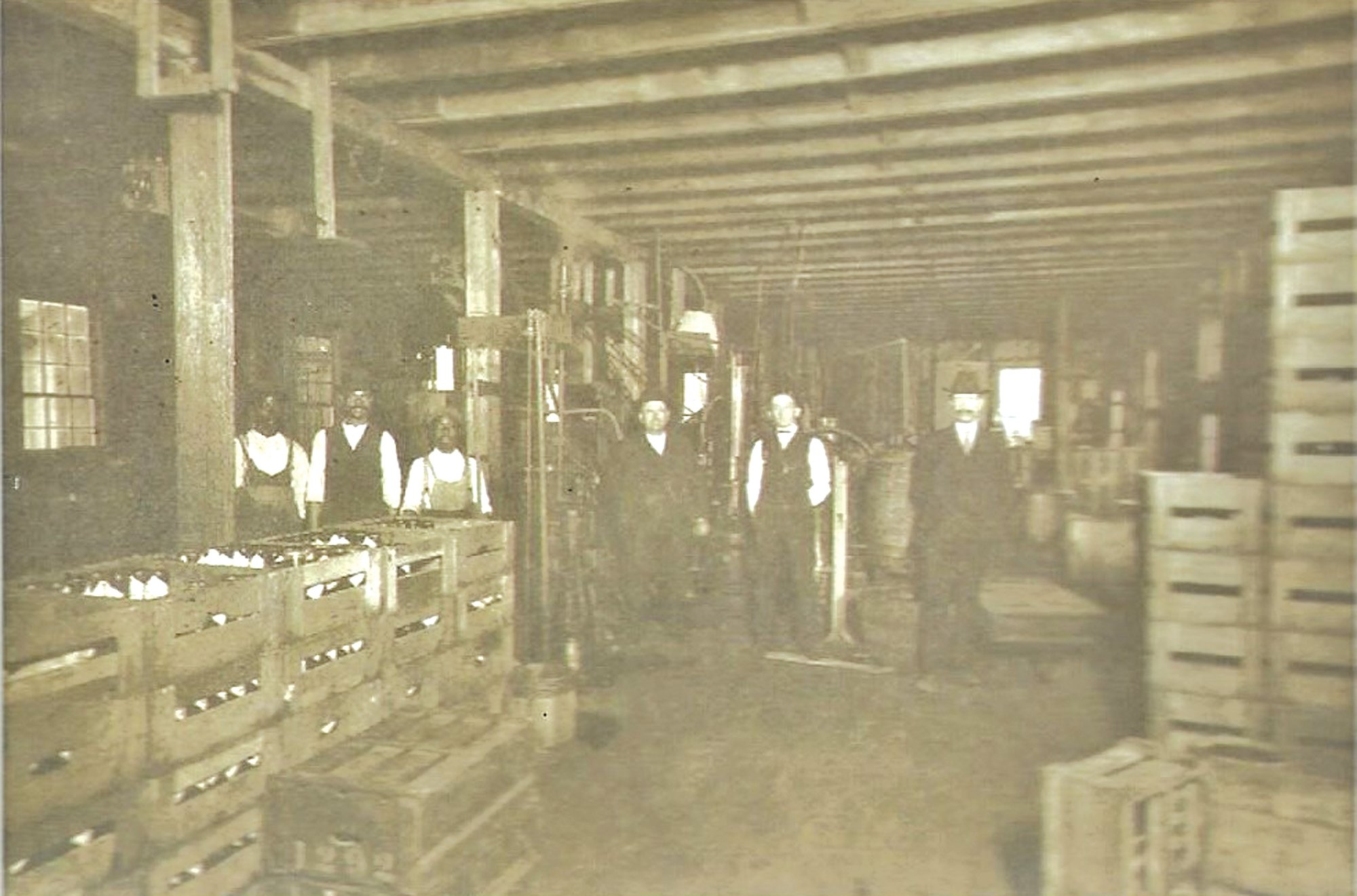"Sumter Bottling Works employees are seen in 1899. Its ""Bludwine"" soda required a disclaimer that it met manufacturing requirements."