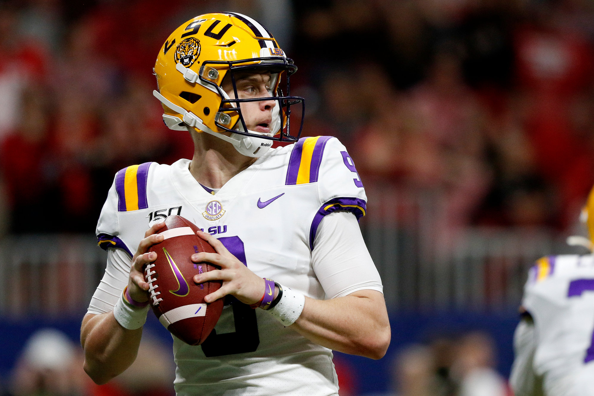 THE ASSOCIATED PRESS  LSU quarterback Joe Burrow (9) will lead the Tigers against fellow quarterback Jalen Hurts and the Oklahoma Sooners in the Peach Bowl College Football Playoff semifinal game in Atlanta on Saturday.