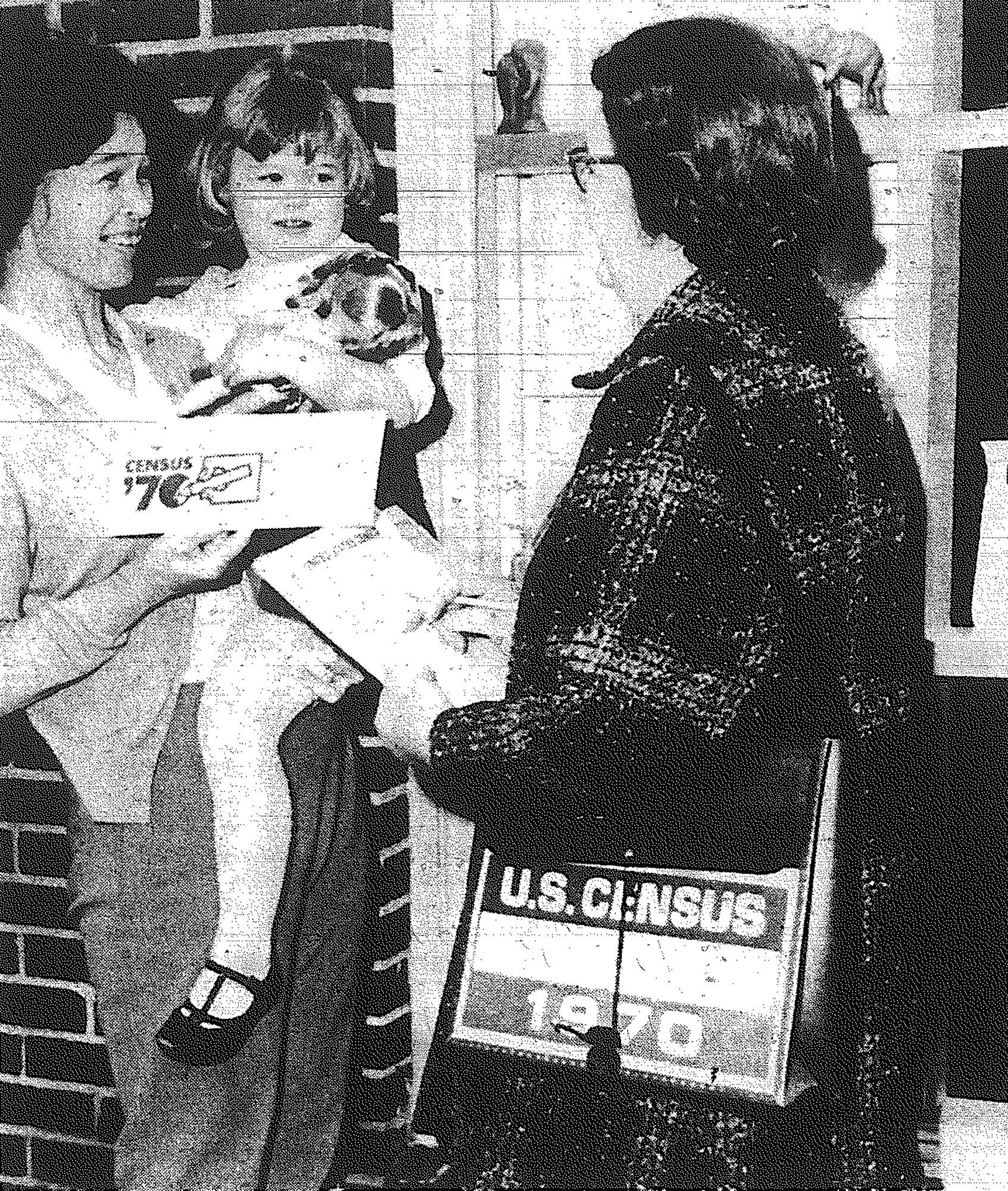 1970 - Mrs. James C. Dennis, one of 18 census workers covering the city in April, collects from Mrs. Mary Tyndall of Victory Drive and her daughter Susanne. The workers were making a block-by-block canvass of the entire city to its corporate limits. They expected to complete their work within three to five weeks.