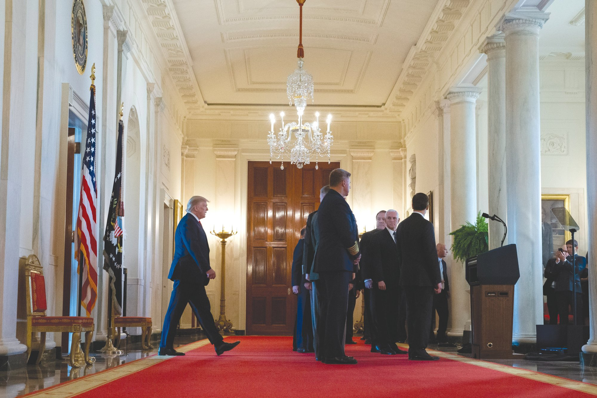 President Donald Trump, left, arrives to address the nation on the ballistic missile strike that Iran launched against Iraqi air bases housing U.S. troops at the White House on Jan. 8 in Washington.