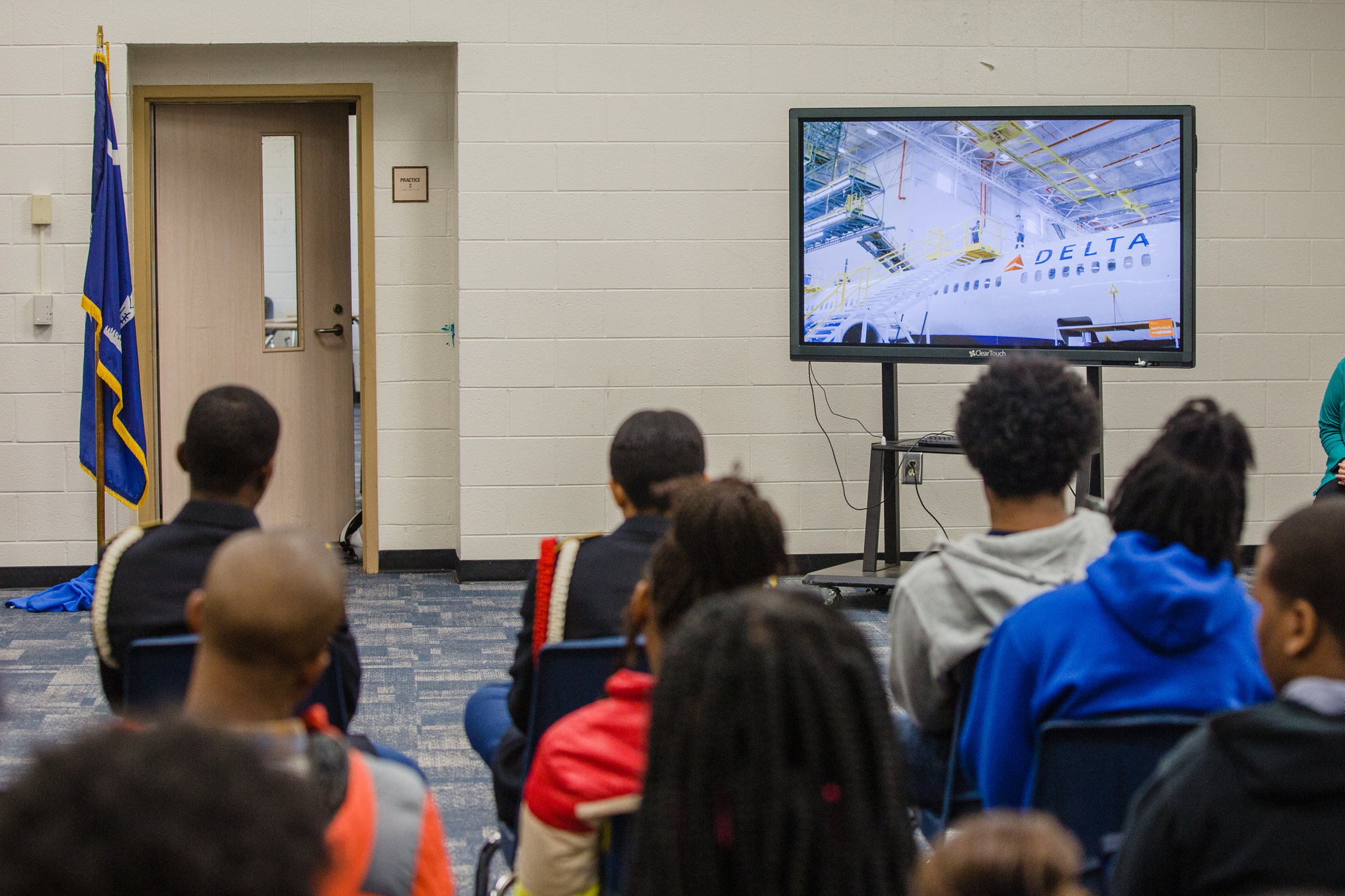 Students at Scott's Branch High School watch a video about careers at Delta Airlines during a presentation by the Pittsburgh Institute of Aeronautics on Wednesday.