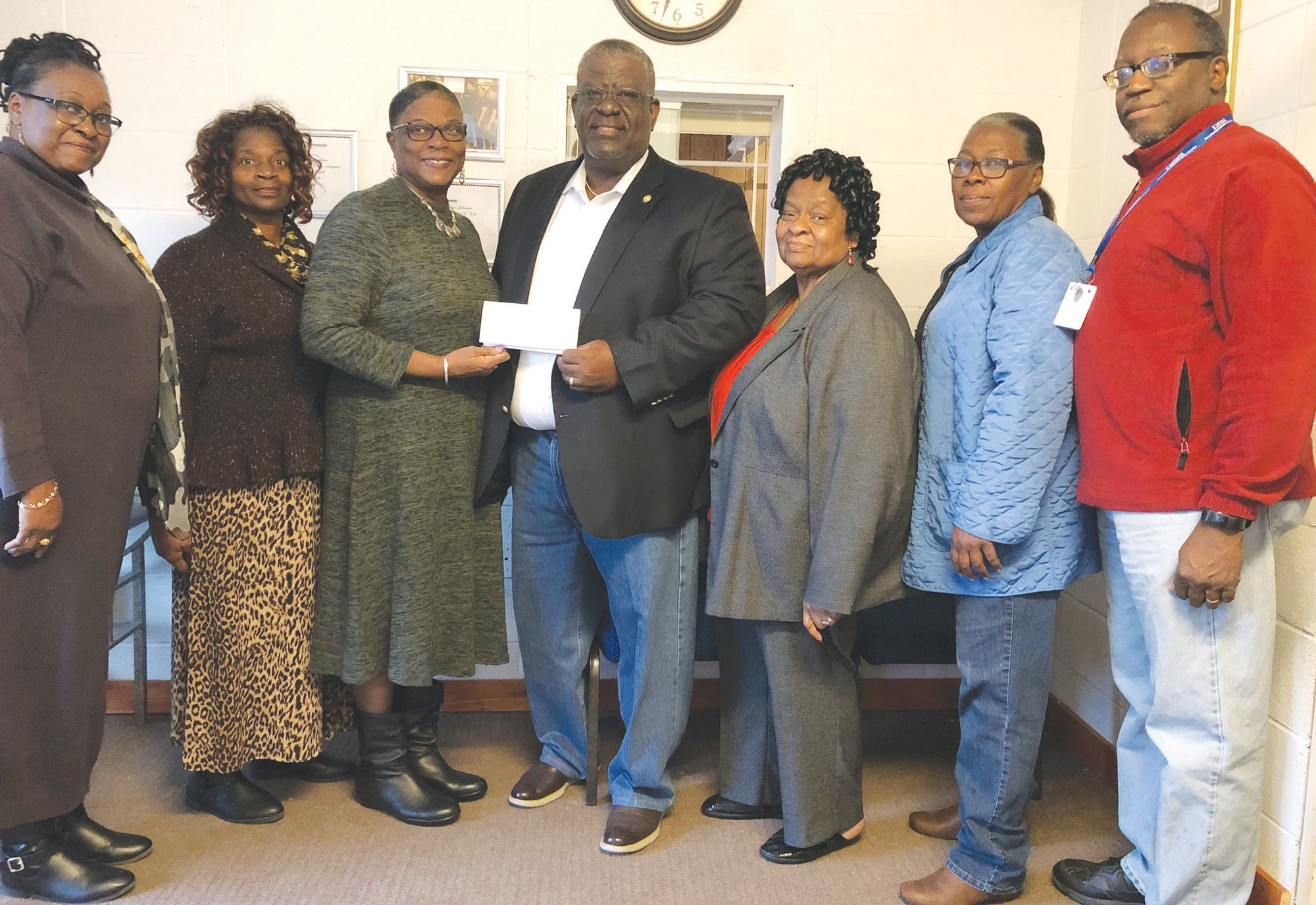PHOTO PROVIDED  Sen. Kevin L. Johnson, D-Manning, presented the Clarendon County Community Development Corp. a check for $100,000 in mid-December that will assist the agency in helping needy families in Clarendon County. Shown with Johnson, center, are Pamela Clavon-Brunson, executive director of the CCCDC; Emma Hilton, CCCDC board member; Paulette King, programs director; Johnson; Loretta W. King, CCCDC consultant; Martha Frierson, CCCDC board member; and the Rev. David Woods, CCCDC board chairman.