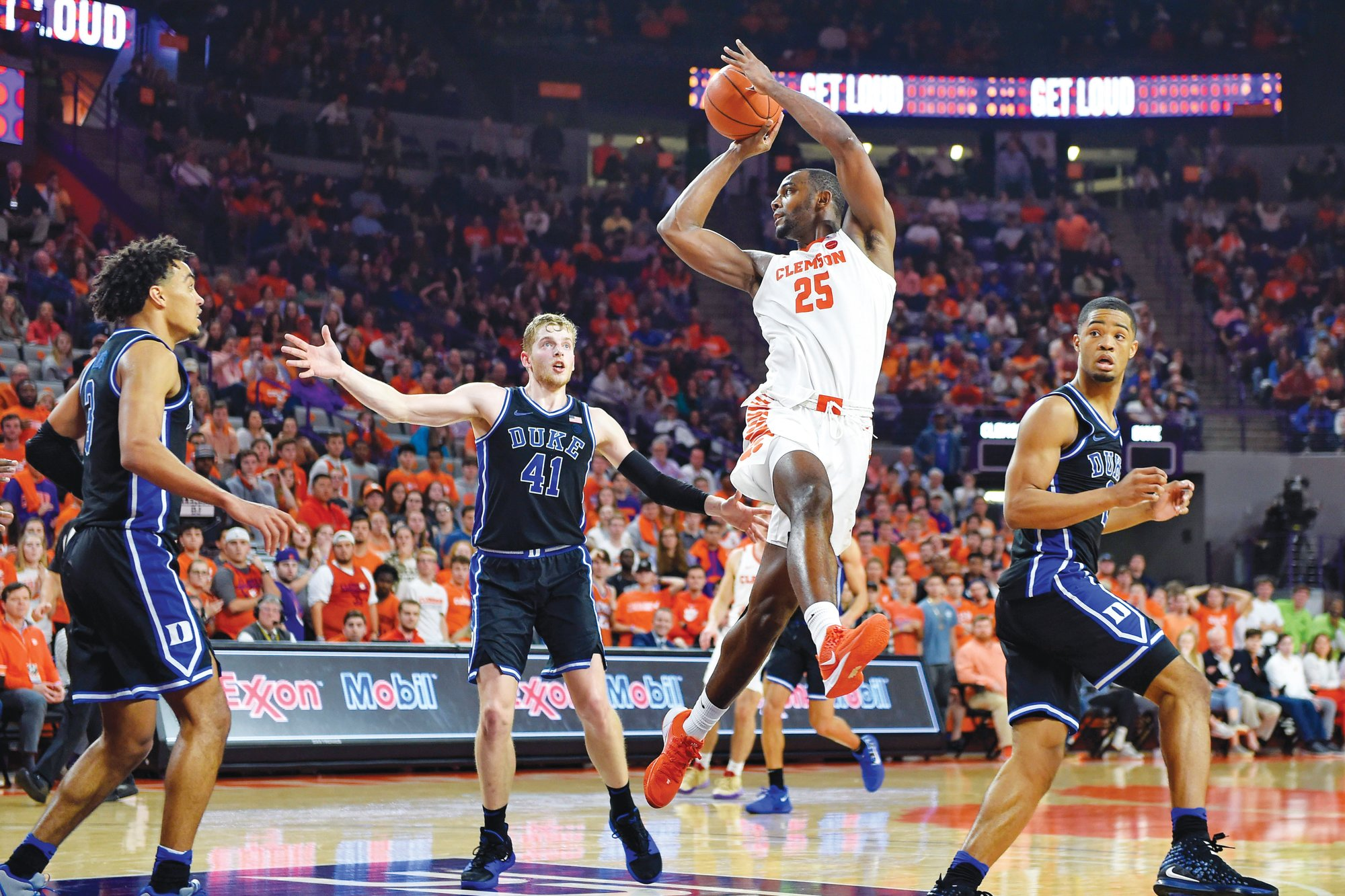 Clemson's Aamir Simms makes a pass (25) under the basket during the Tigers' 79-72 win over Duke on Tuesday in Clemson.