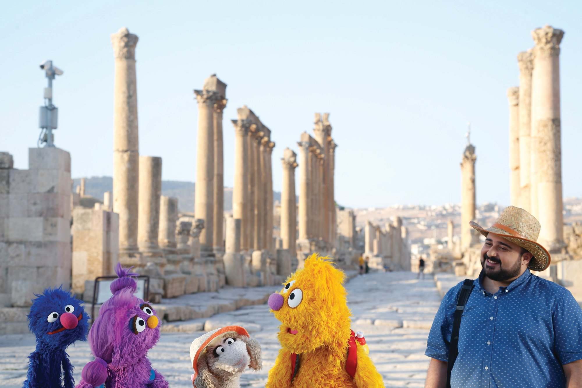 "From left are Grover, Basma, Ma'zooza and Jad with Rami Delshad, who portrays Hadi in ""Welcome Sesame,"" a new, locally produced Arabic TV program for the hundreds of thousands of children dealing with displacement in Syria, Iraq, Jordan and Lebanon."