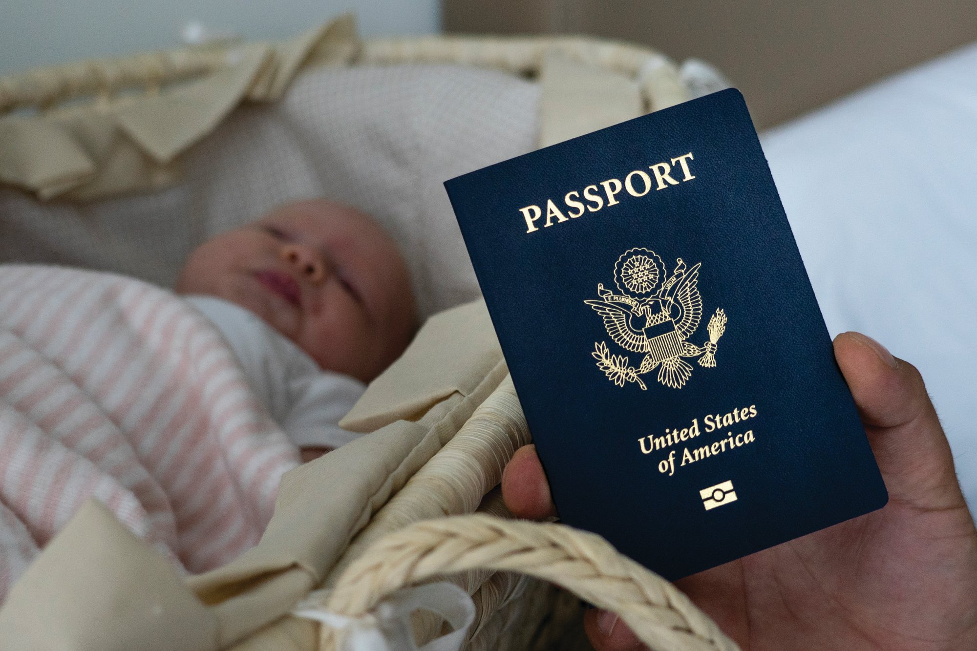 In this photo taken on Jan. 24, 2019, Denis Wolok, the father of then 1-month-old Eva, shows the child's U.S. passport during an interview with The Associated Press in Hollywood, Florida. Russian women, like Wolok's wife, Olga Zemlyanaya, travel to the United States to give birth so that their child can acquire all the privileges of American citizenship.
