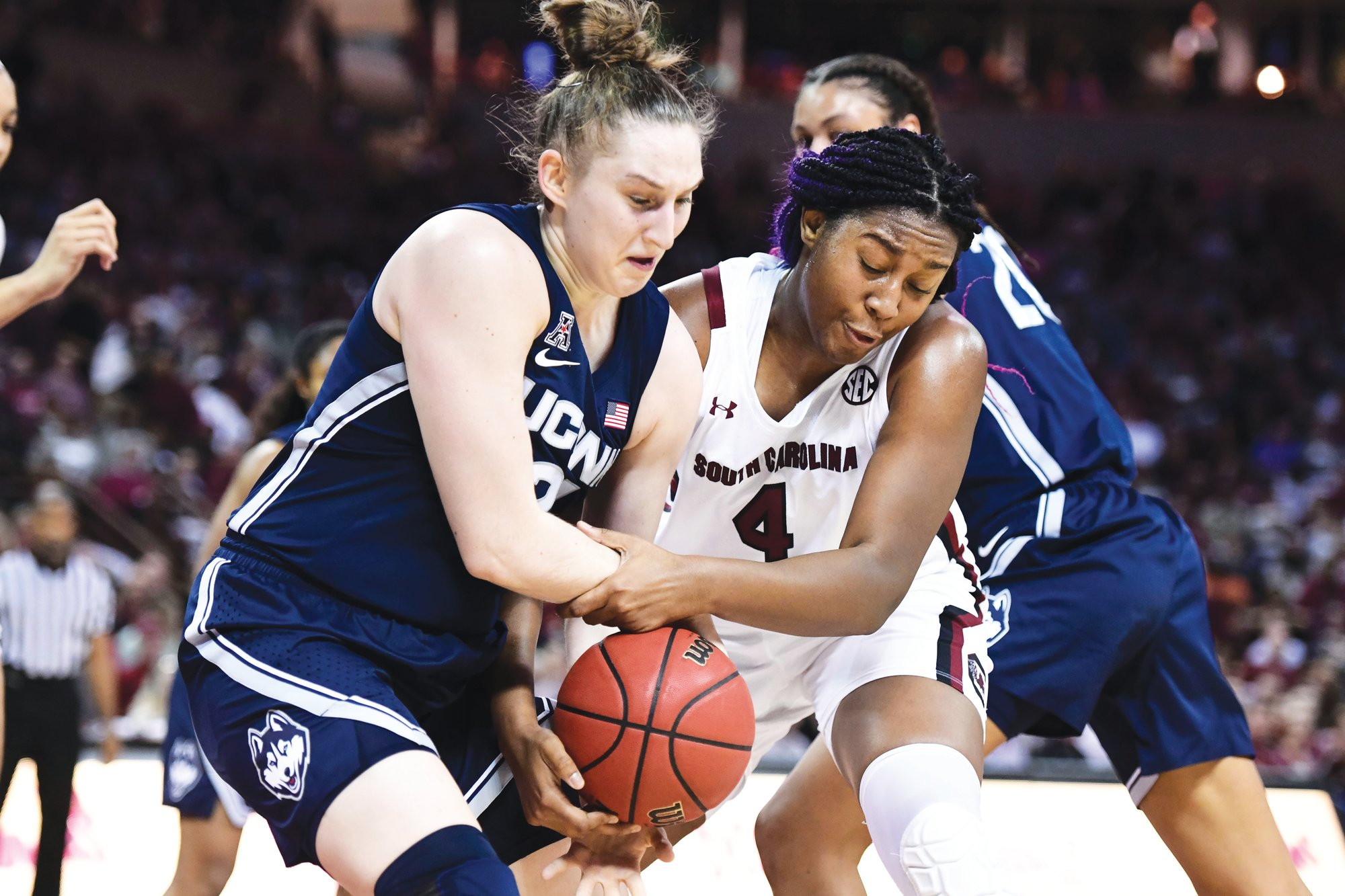 South Carolina forward Aliyah Boston (4) battles for a rebound against Connecticut guard Anna Makurat during the Gamecocks' 70-52 win on Monday in Columbia.