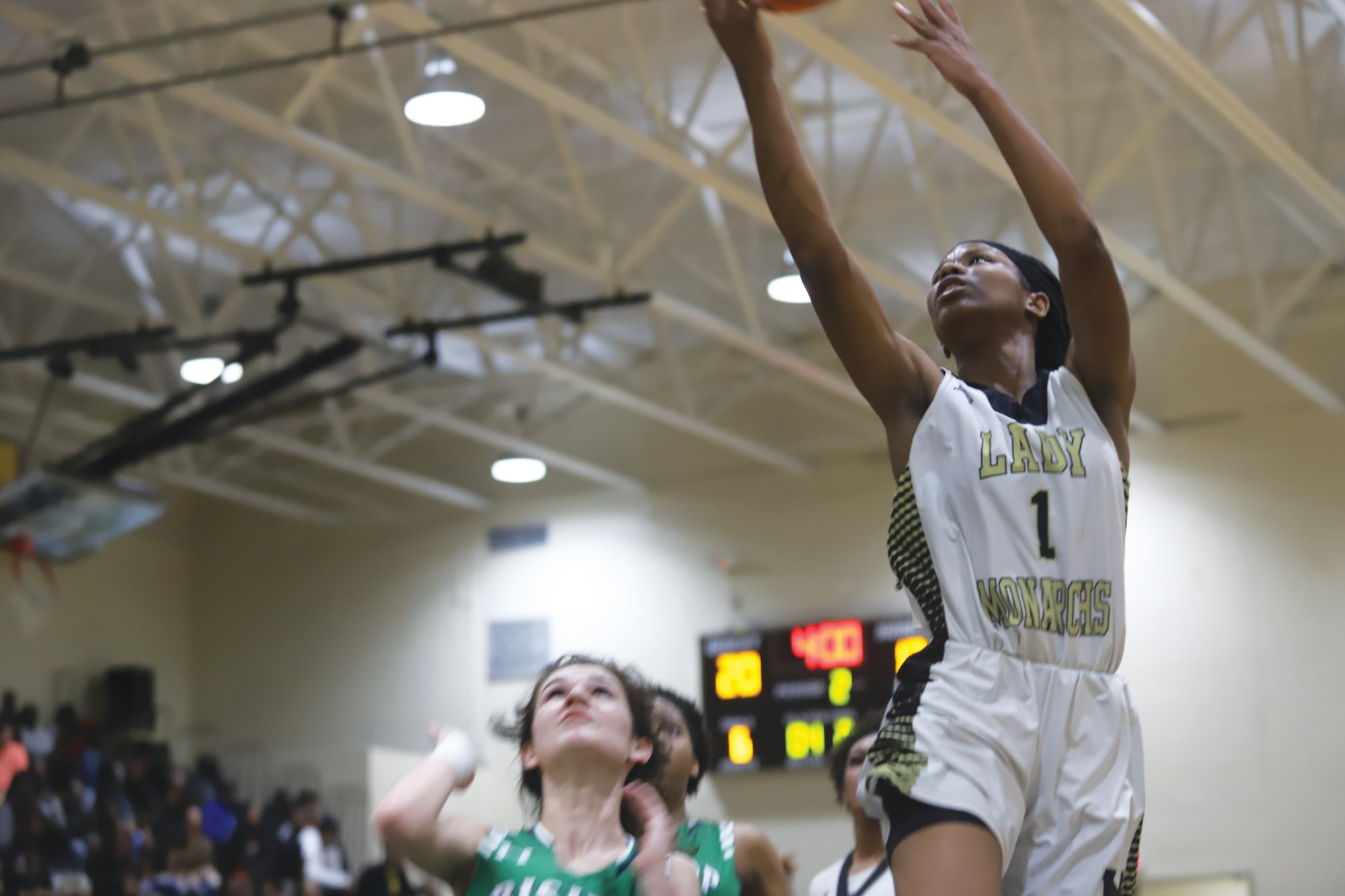 Manning's Measha Jones goes up for a layup against Bishop England on Tuesday. Jones led the Lady Monarchs with 14 points in the 46-29 loss.