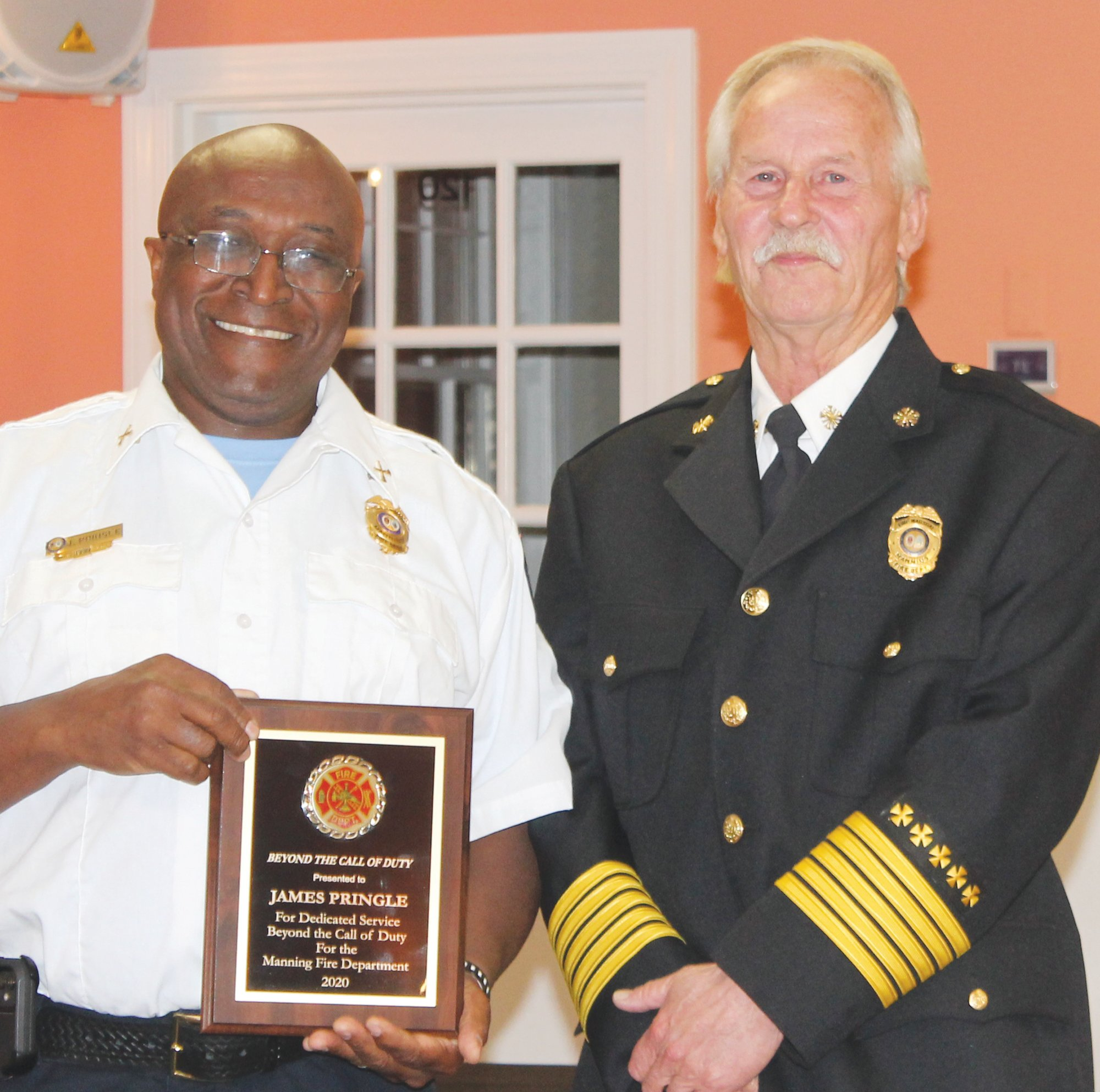 Manning Fire Chief Mitch McElveen presented Capt. James Pringle with the department's Beyond the Call of Duty award for his contributions to both the department and his community.