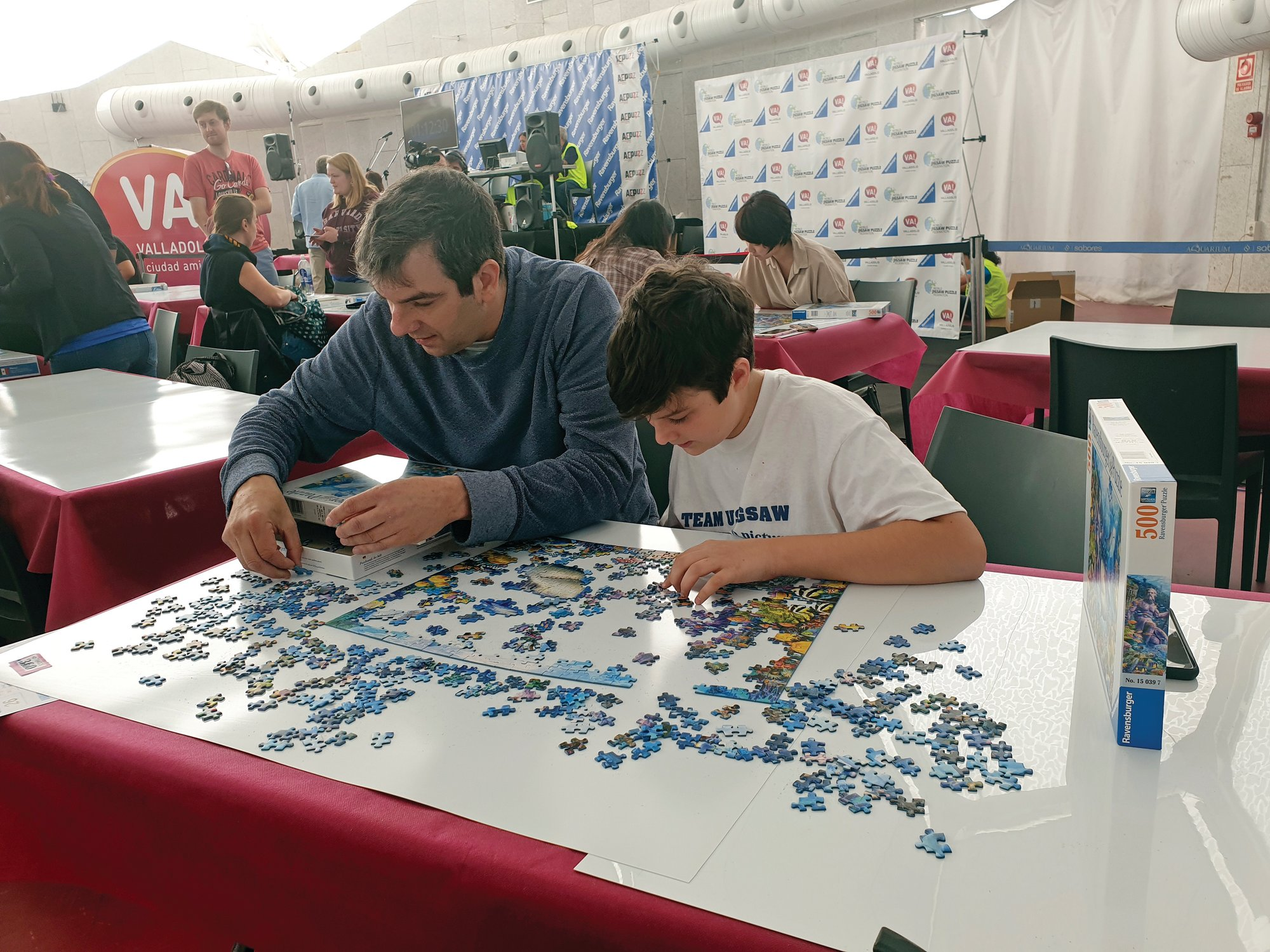 Julie Jacobs via AP   A.J. Jacobs and his 13-year-old son, Zane, are seen during an event at the 2019 World Jigsaw Puzzle Championship in Spain. There were 40 countries represented at this competition.