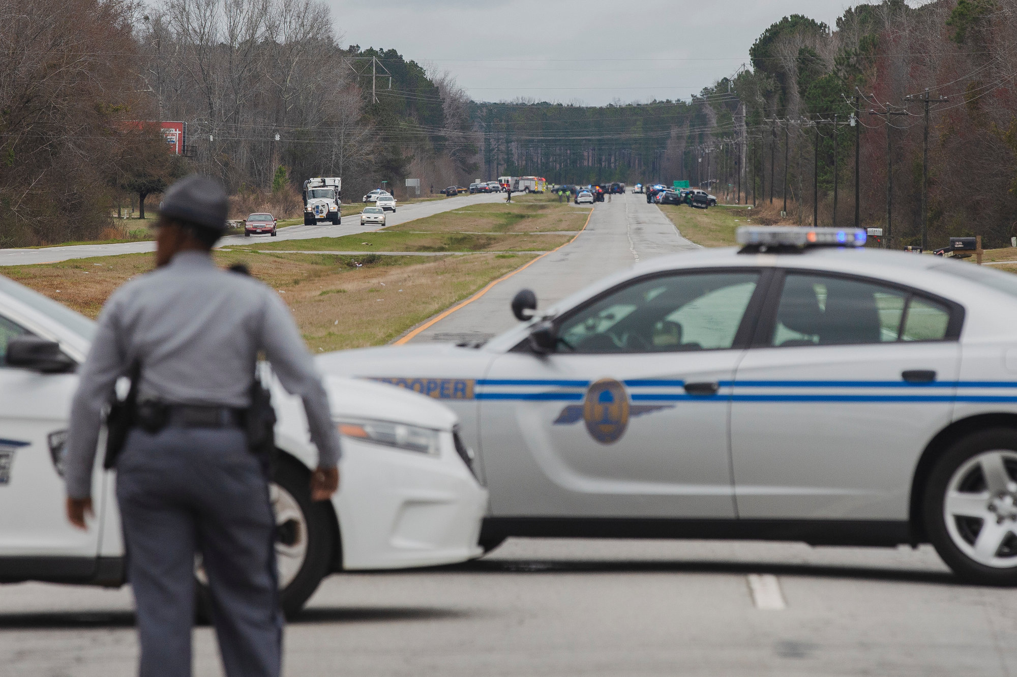 U.S. 521 is seen blocked at Four Bridges Road as a heavy law enforcement response can be seen in the distance.