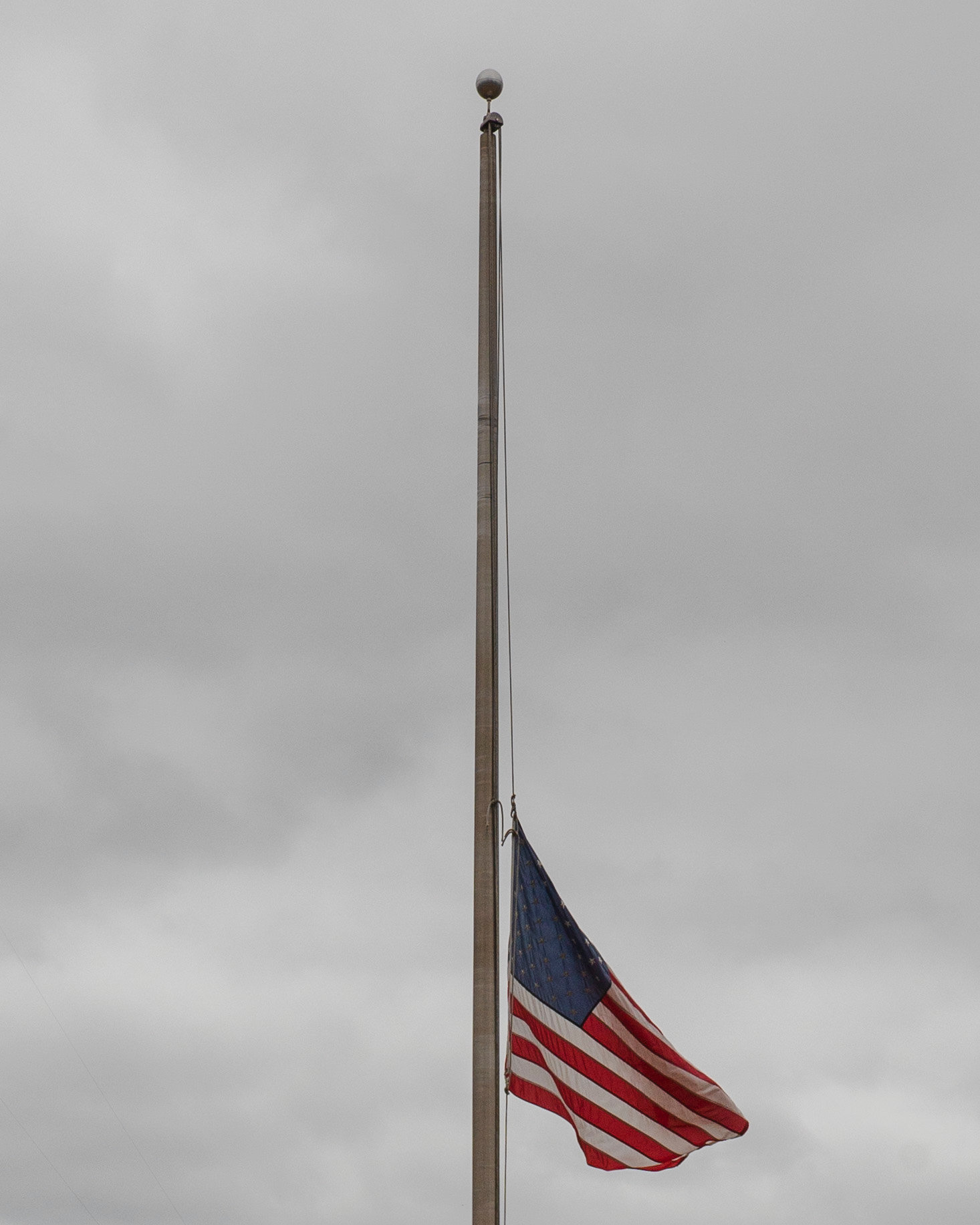 The flag flies at half staff Tuesday in front of the Sumter County Sheriff's Office headquarters.