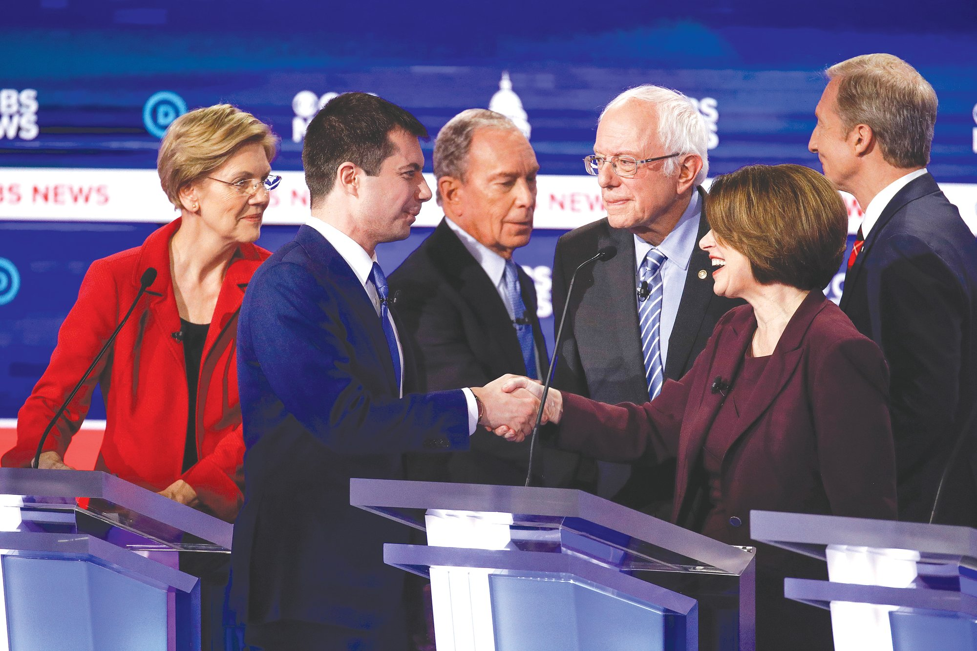 From left, Democratic presidential candidates, Sen. Elizabeth Warren, D-Mass.; former South Bend Mayor Pete Buttigieg; former New York City Mayor Mike Bloomberg; Sen. Bernie Sanders, I-Vt.; Sen. Amy Klobuchar, D-Minn.; and businessman Tom Steyer greet one another on stage at the end of the Democratic presidential primary debate at the Gaillard Center on Tuesday in Charleston, co-hosted by CBS News and the Congressional Black Caucus Institute.