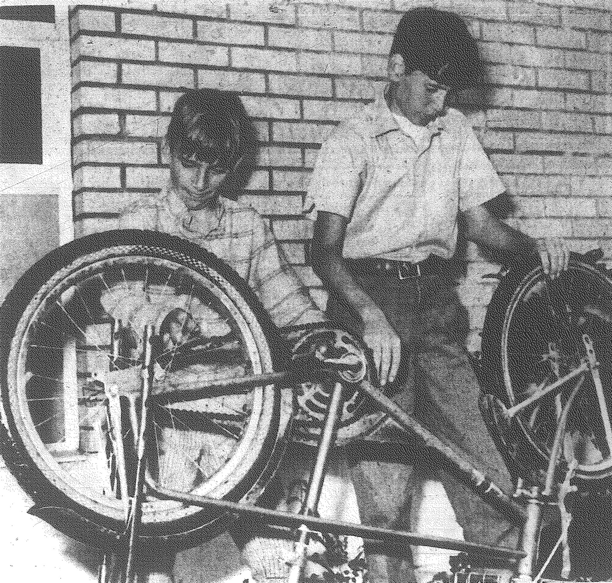 1970 - Two Item carriers get their two-wheelers in shape May 25 for a Bicycle Rodeo at the Sumter County Library with a parade down Harvin Street. The rodeo was open to all boys and girls from 6 to 15. Winners were chosen for having the most beautiful bike, most original and most artistic.