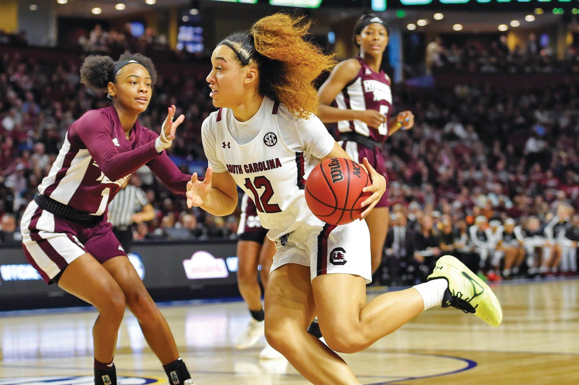 South Carolina's Brea Beal (12) drives while defended by Mississippi State's Myah Taylor (1) during the Gamecocks' 76-62 win in the SEC championship on Sunday in Greenville.