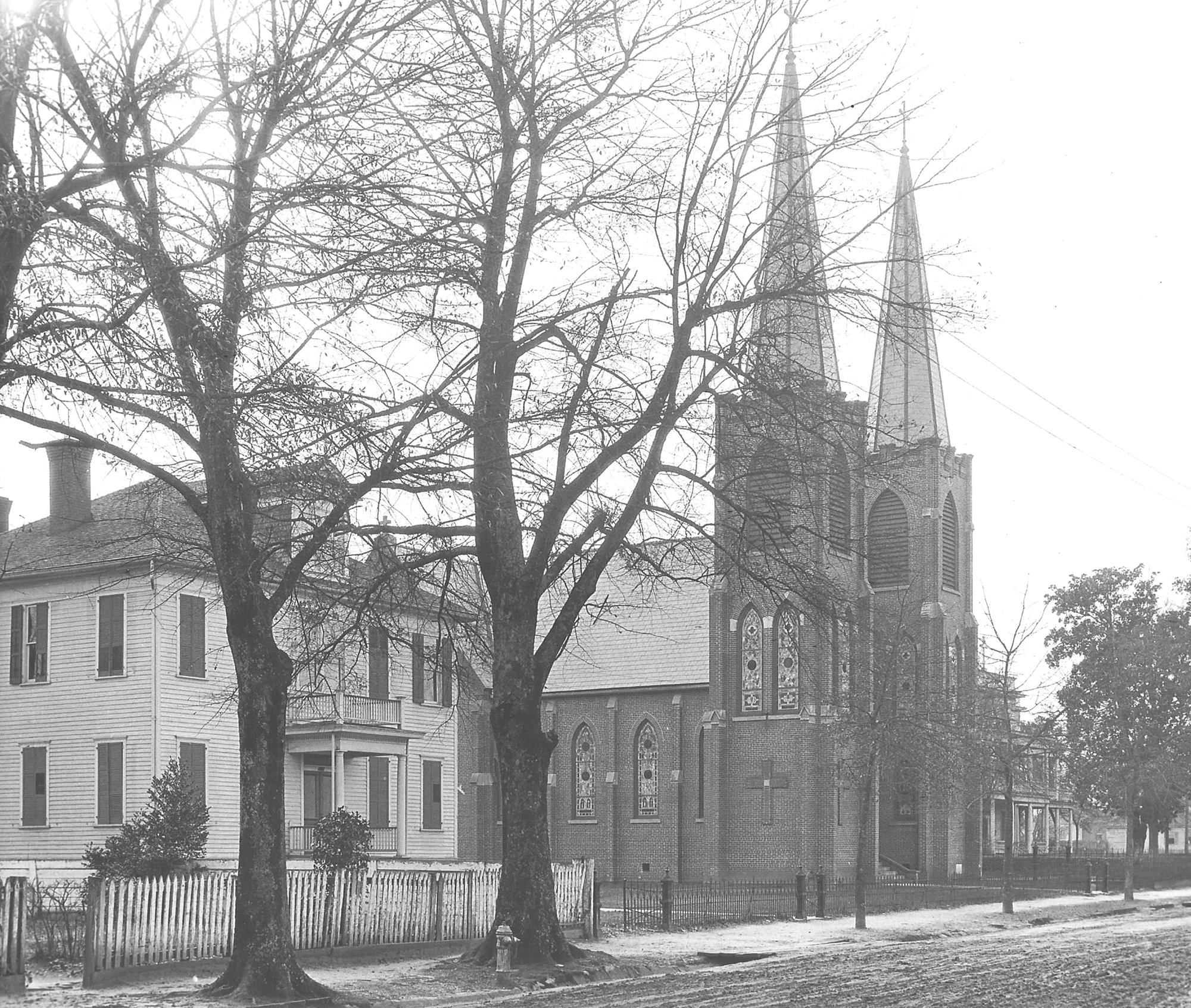 St. Anne Catholic Church rectory, the church and St. Joseph Academy are seen in 1915. A parish was first established in Sumter in 1837 with Father Quigley serving as pastor.