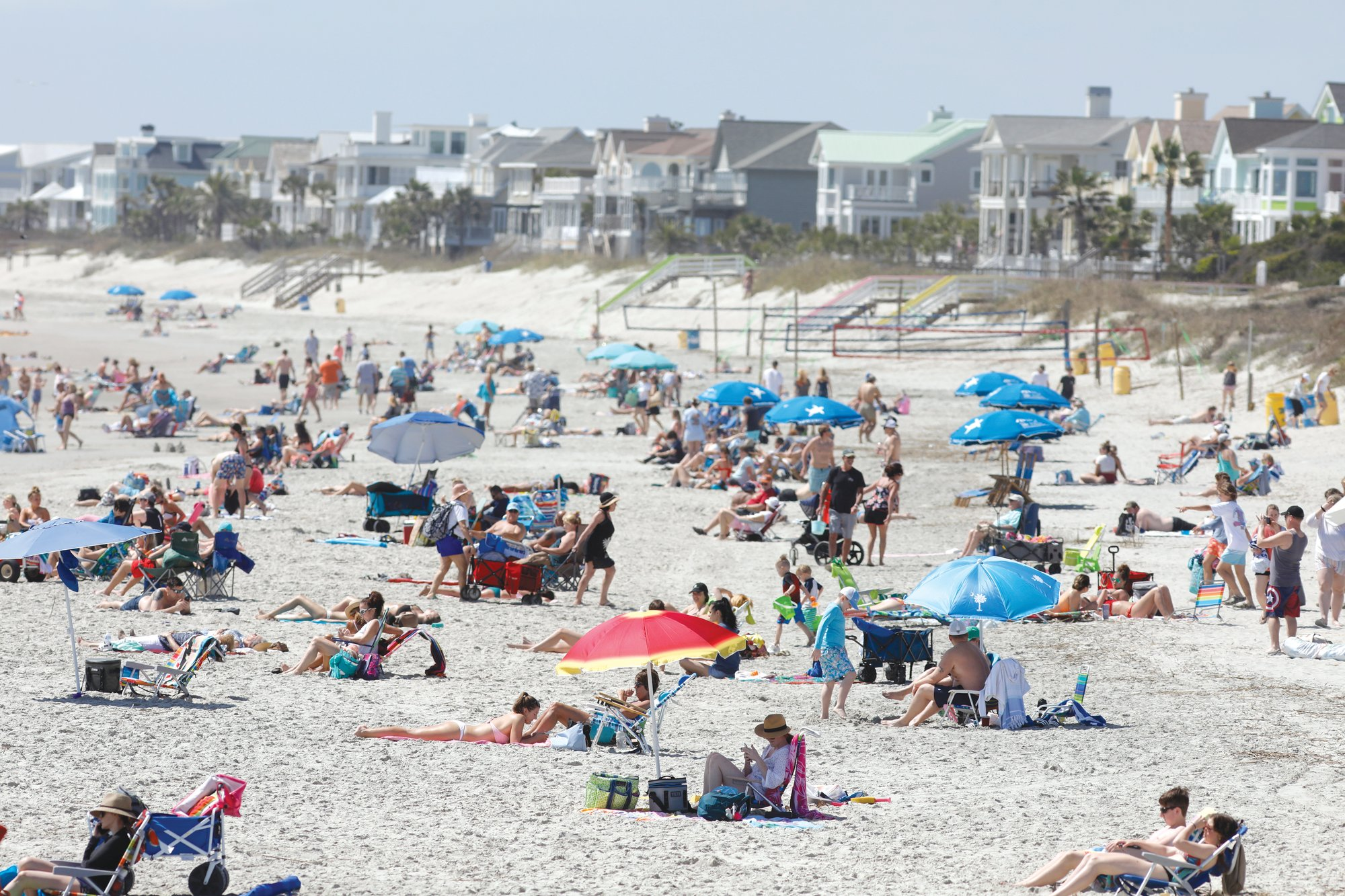 Despite warnings from government officials to take caution and self distance because of coronavirus, beachgoers enjoy the Isle of Palms beach Friday in Isle of Palms. City authorities are restricting access to the popular beach from 7 a.m. to 7 p.m. daily to help stop the spread of the coronavirus.